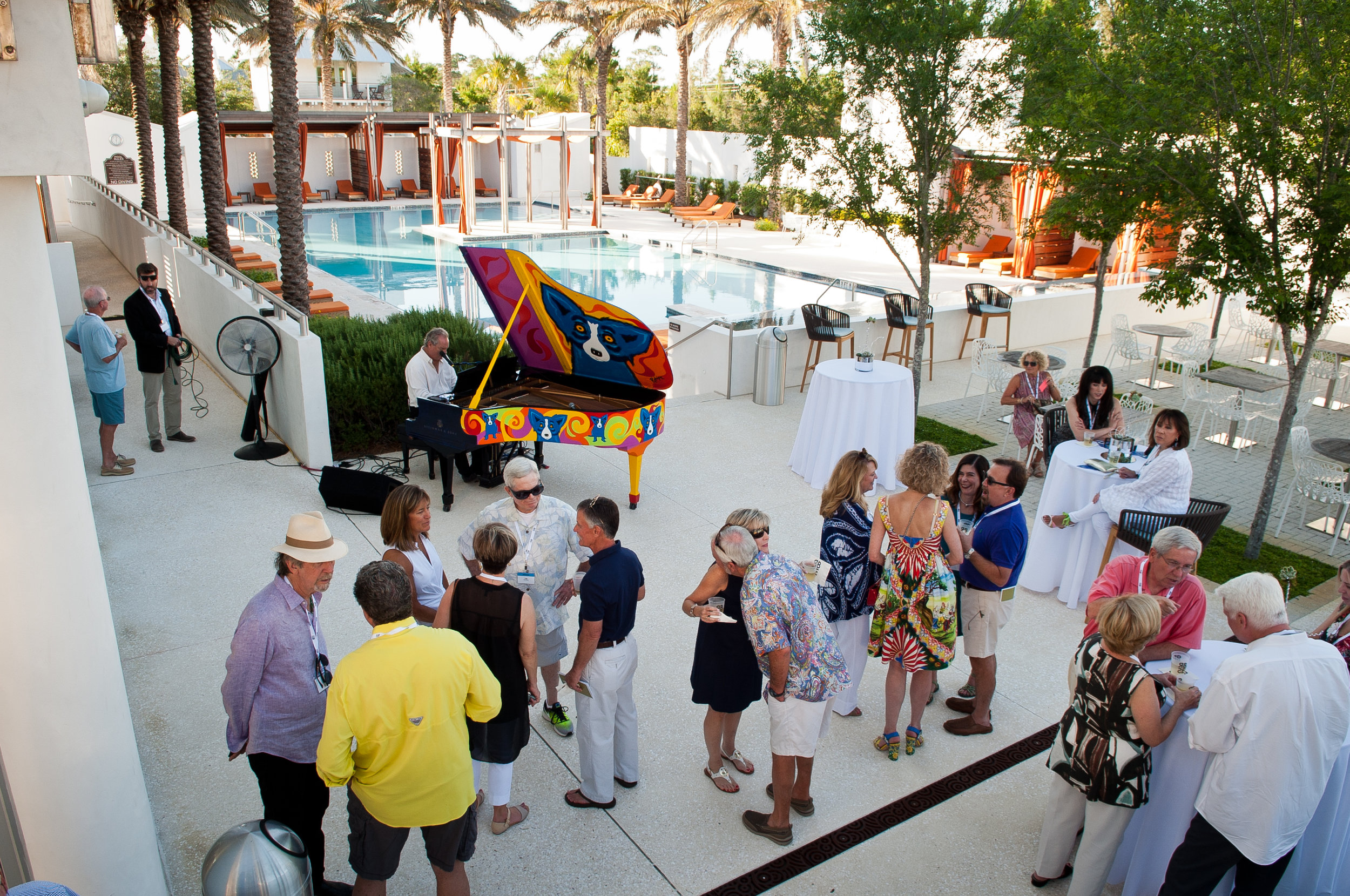- Guests enjoy music by David Seering at the Rodrigue Steinway Event. (Photo by Brandan Babineaux Photography.)
