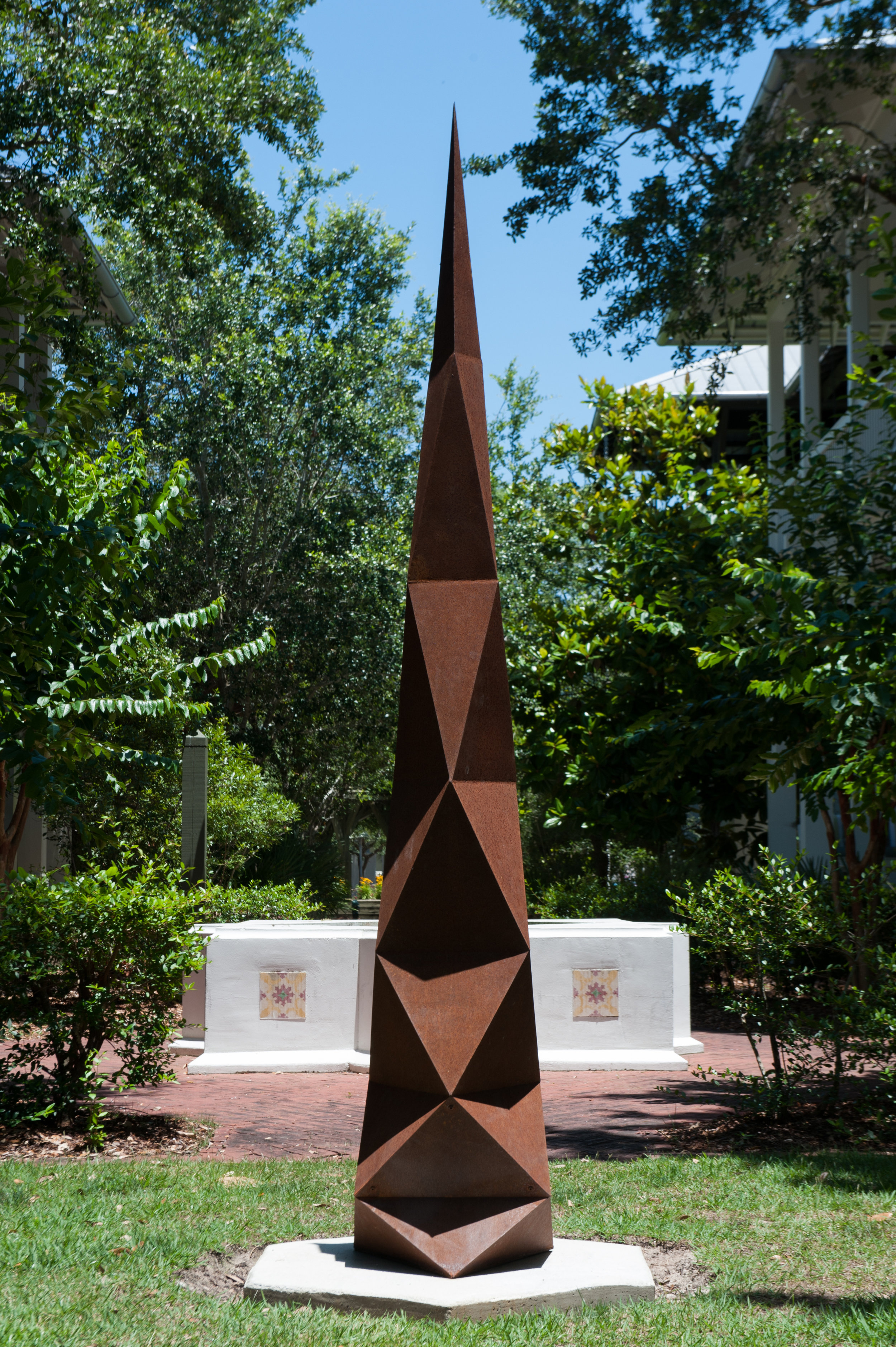 "- MATTHEW MOSHERb. 1982Natick, MassachusettsVajramantrabhiru, 2017Weathering steel21"" x 21"" x 108""$8,770This steel sculpture uses a series of increasing triangular facets to create a geometric form. Each face catches light in a unique way because it is at a different angle relative to the others. They reach skyward, defying gravity.. . .Vajramantrabhiru is triangular. This causes the sculpture to appear to change radically in form when viewed from different angles; sometimes it seems to be a smooth spire while from a different perspective it is a jagged zig zag. The sculpture is named after the eighth guardian deity in Tibetan Buddhism, the protector against false speech."