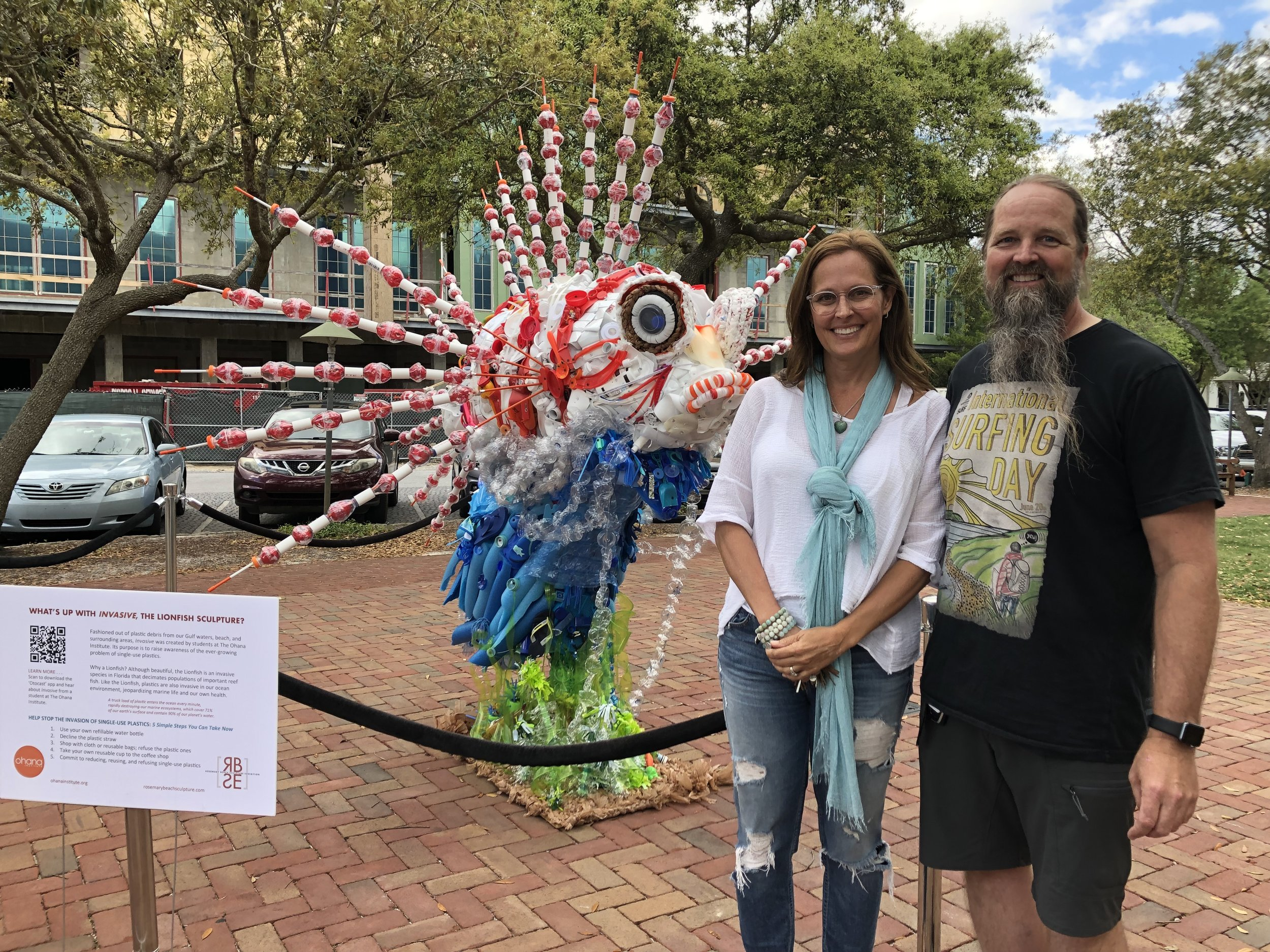 The students at Ohana Institute created  Invasive , the Lionfish sculpture, under the direction of Art Teacher, Julie Martin, left, and Science Teacher, Mike Sturdivant.