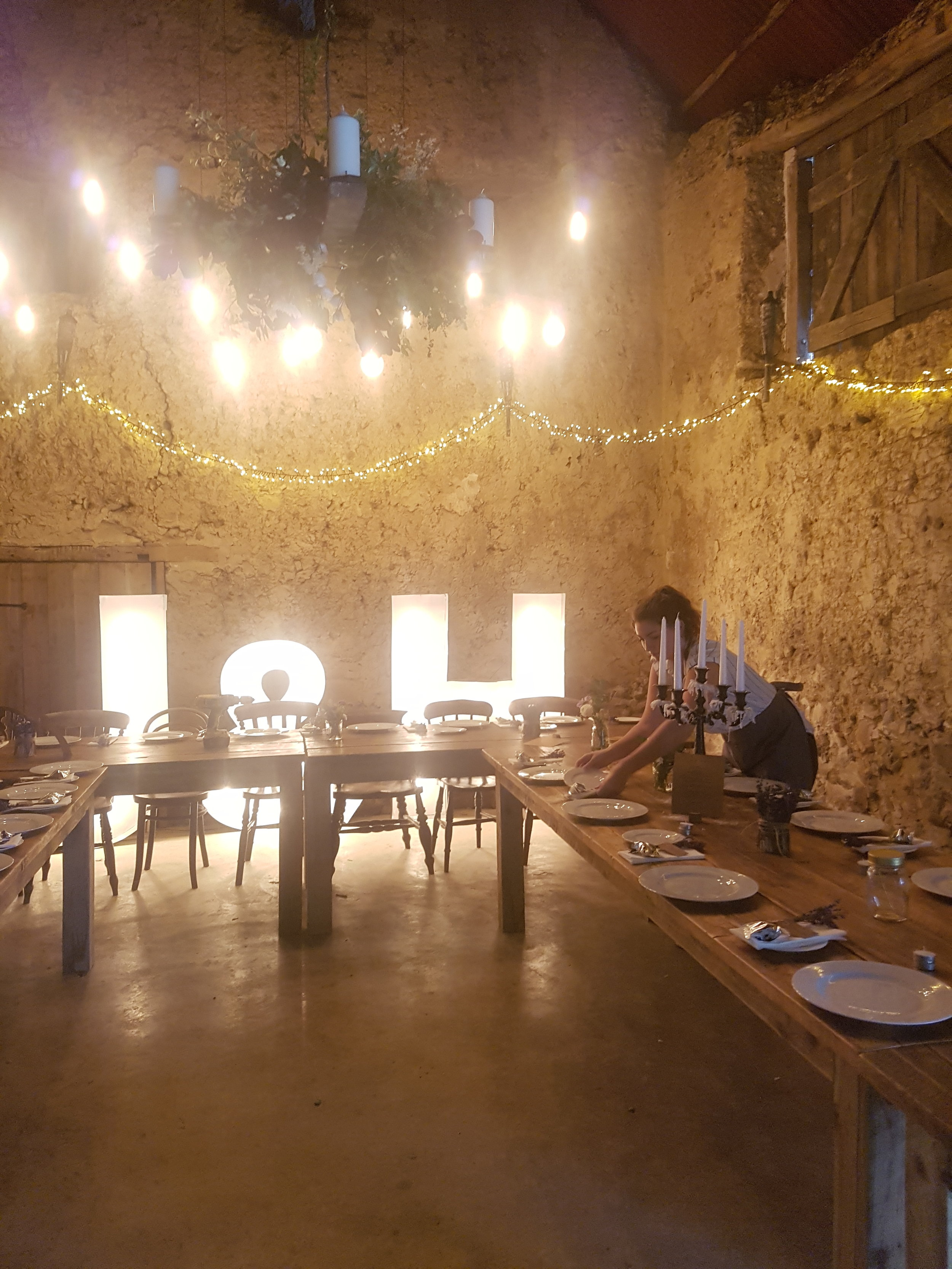 Assistant manager Maddie overseeing the final touches in the beautiful medieval barn at Higher Eggbeer.