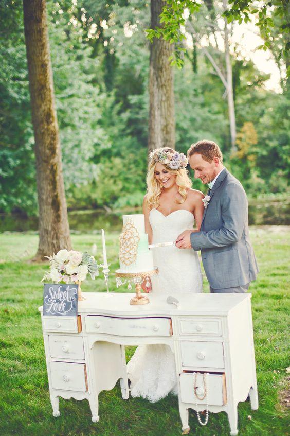 Gold Chandelier Ball Base Cake Stand on vintage desk by Opulent Treasures   Wedding Cake Table Ideas   bride&groom