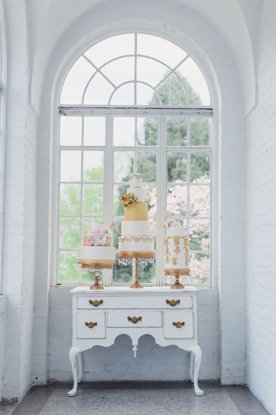 Gold ChandelierWedding Cake Stands on vintage desk   Opulent Treasures