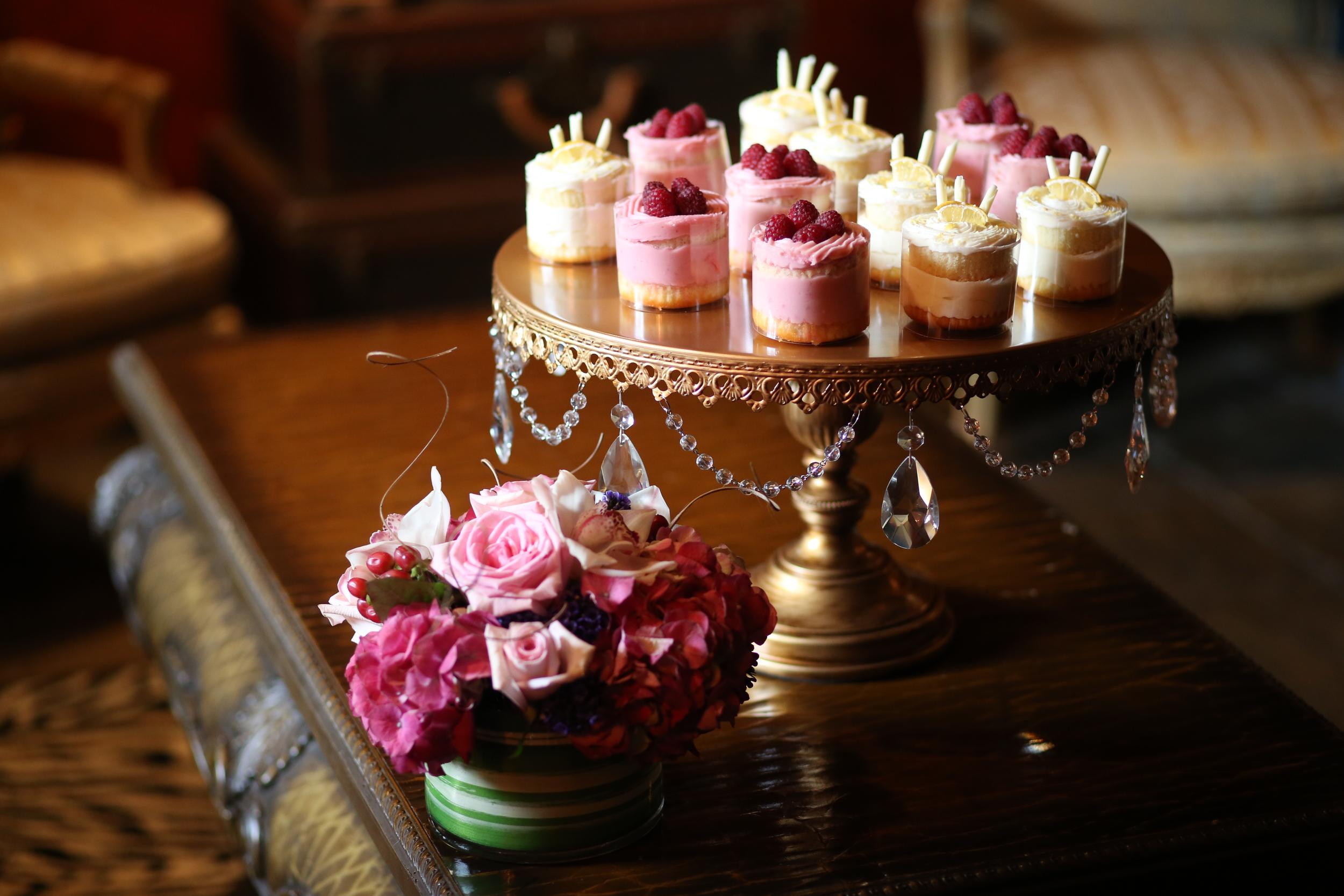 Mini desserts on gold chandelier cake stand   Opulent Treasures