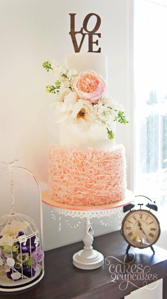 LOVE Cake Topper   Peach Ruffled Frosting   Fresh Flowers   White Chandelier Cake Stand