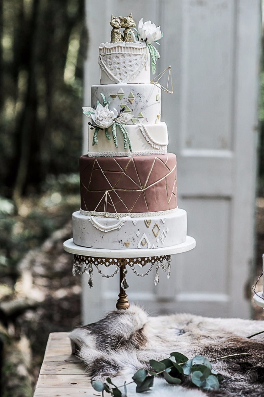 Our antique gold chandelier cake stand couldn't complement the boho vibe any better!    Opulent Treasures