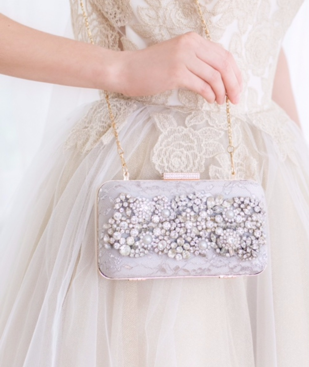 Obsessed with this minaudière. The vintage jewels over lace... Love.    Cloe Noel
