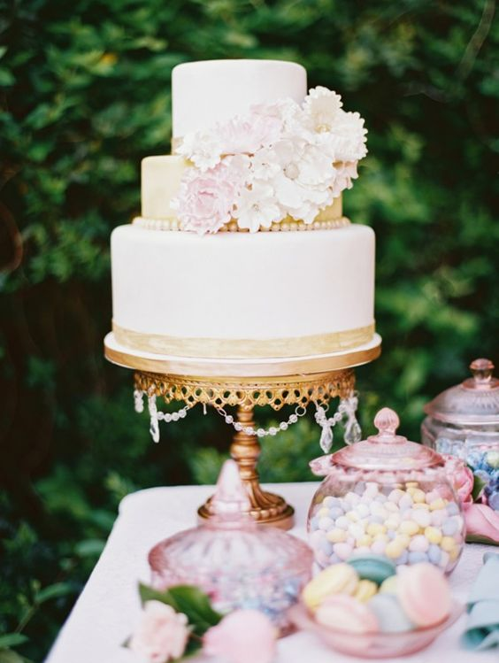 Pretty Pastels are perfect on Gold Chandelier Cake Stand / Photo:  Jo Photo