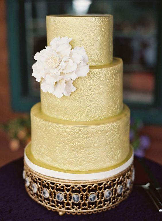 yellow tiered wedding cake on gold moroccan jeweled cake stand.jpg