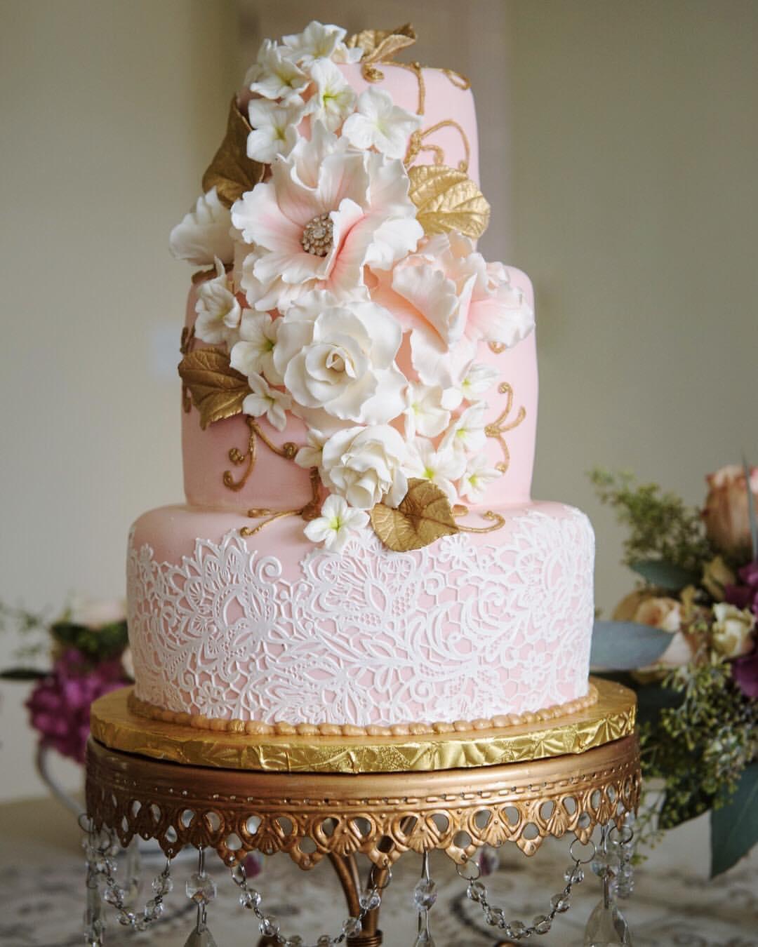 blush pink wedding cake by plumeria cake studio-gold chandelier cake stand by opulernt treasures.jpg
