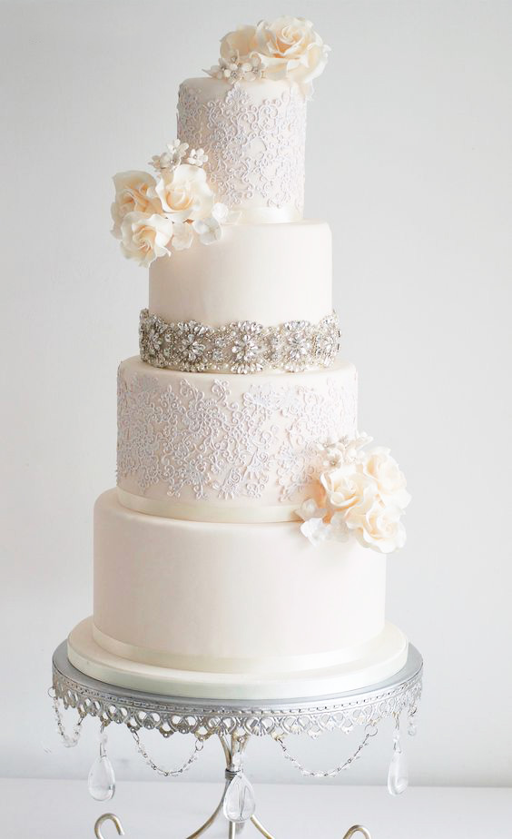 white ivory tiered wedding cake by sugar ruffles  silver cake stand by opulent treasures.jpg