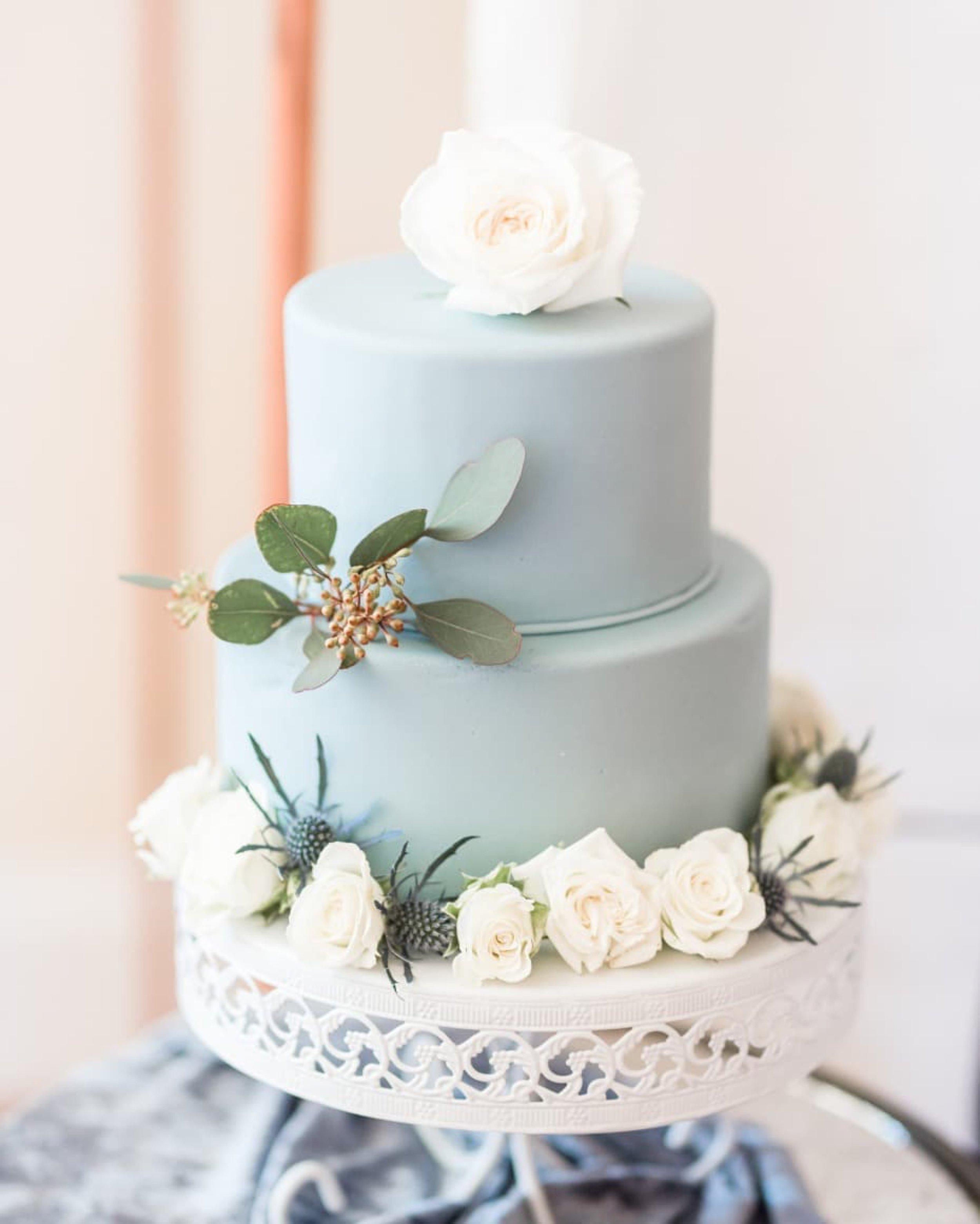 Blue wedding cake on white loopy band cake stand.jpg