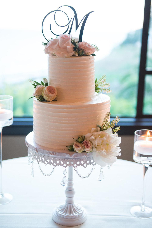 Blush tiered wedding cake white chandelier cake stand opulent treasures.jpg