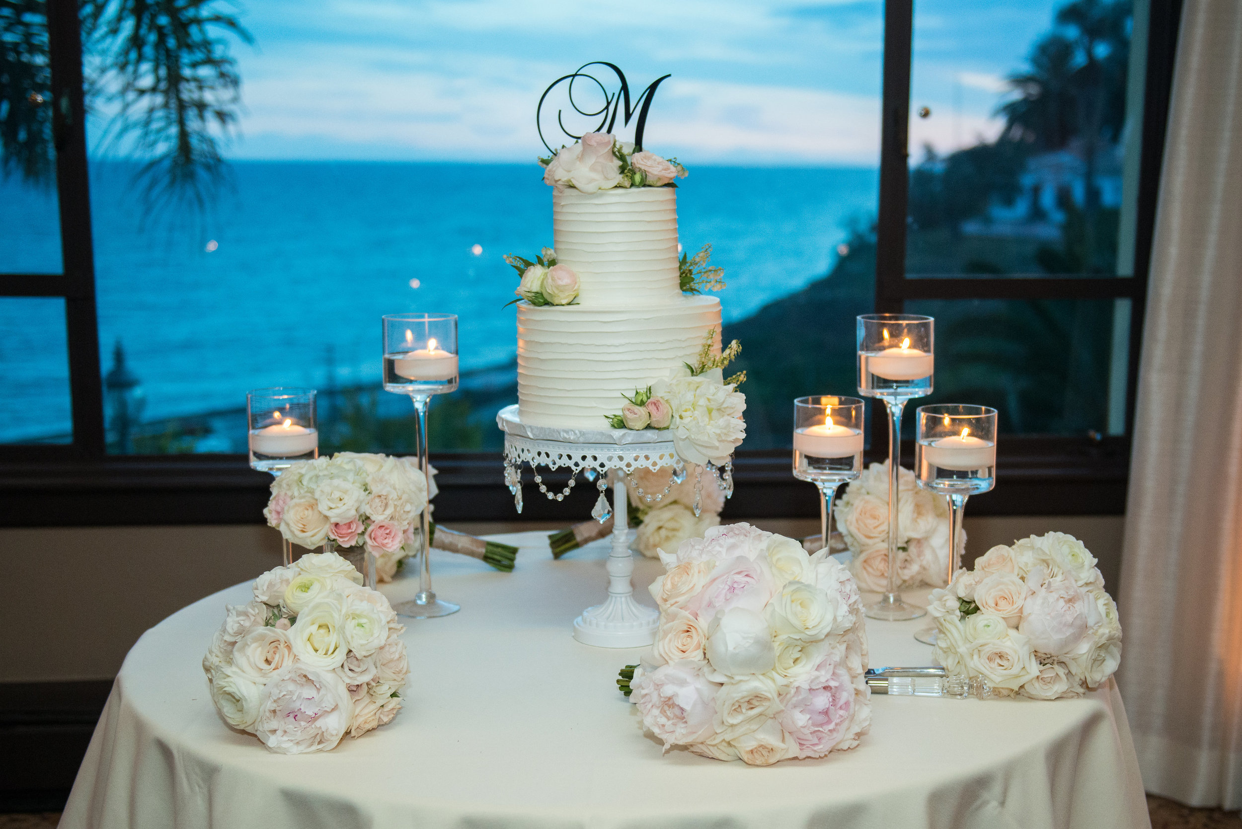 white tiered wedding cake white chandelier cake stand opulent treasures.jpg