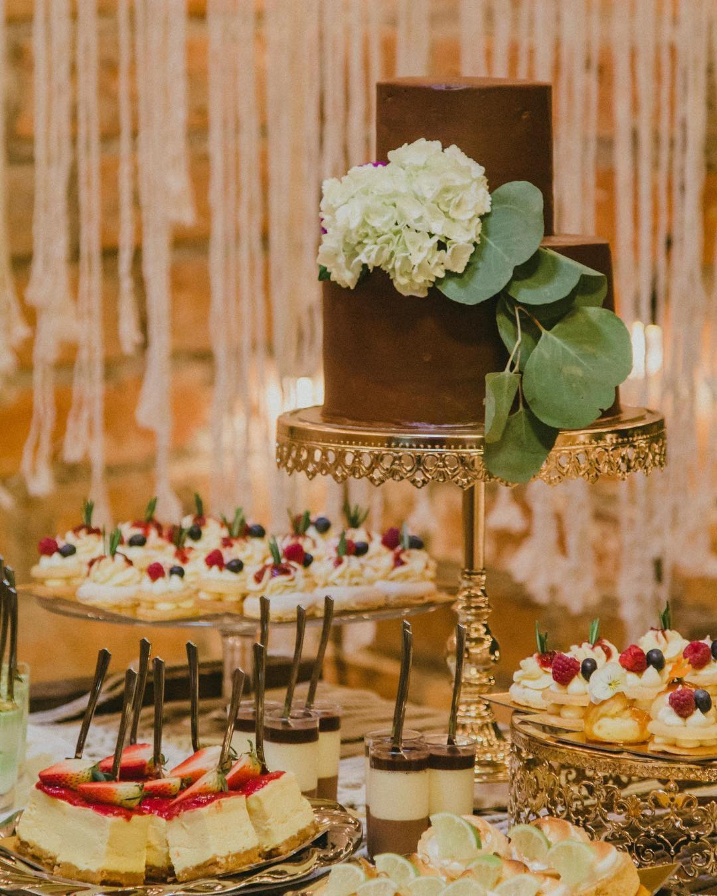 cake by @cakehomereposteria opulent treasures shiny gold cake stand.jpg