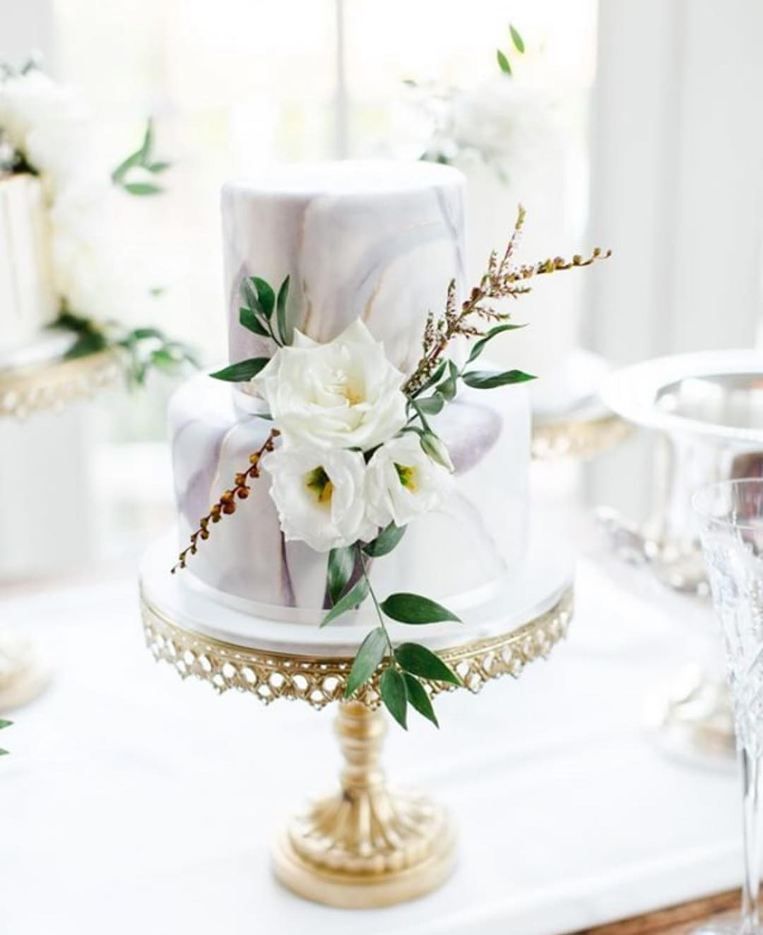 marble wedding cake by cake envy ga opulent treasures cake stand.jpg