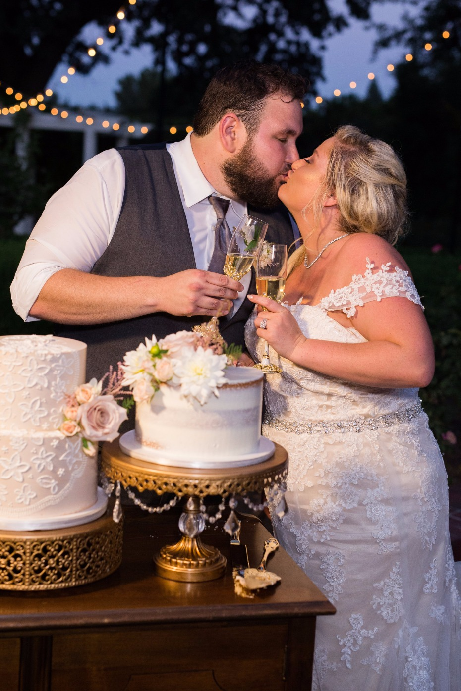 bride and groom kissing cake table .jpg