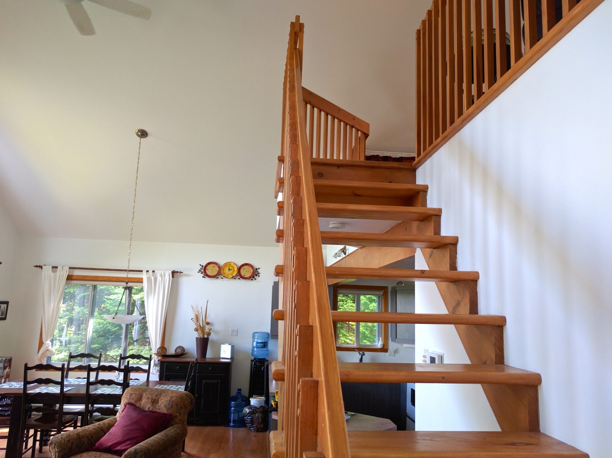 Stairs up to loft hideaway with reading area and two single beds