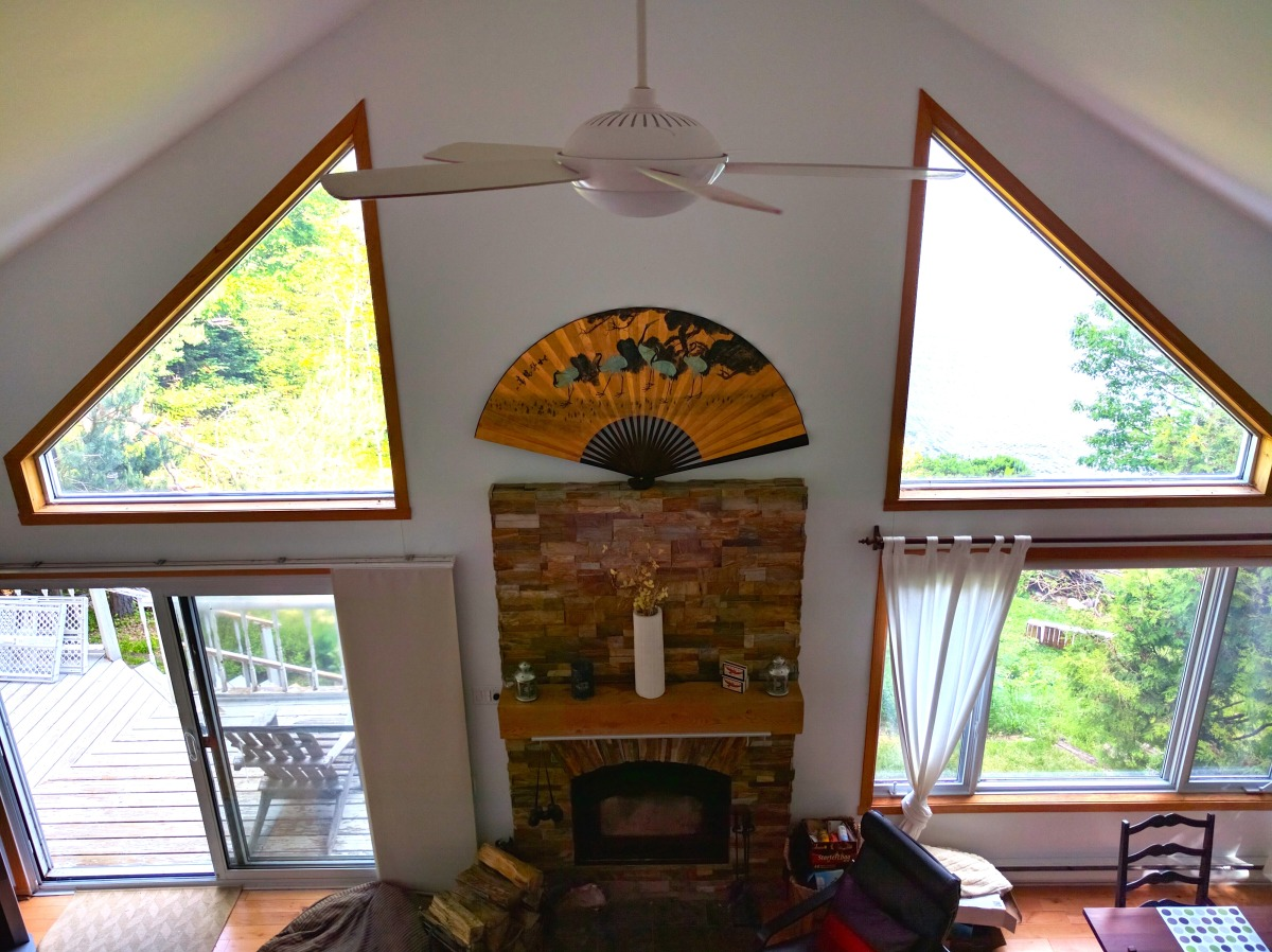 View of living room and fireplace from upstairs loft