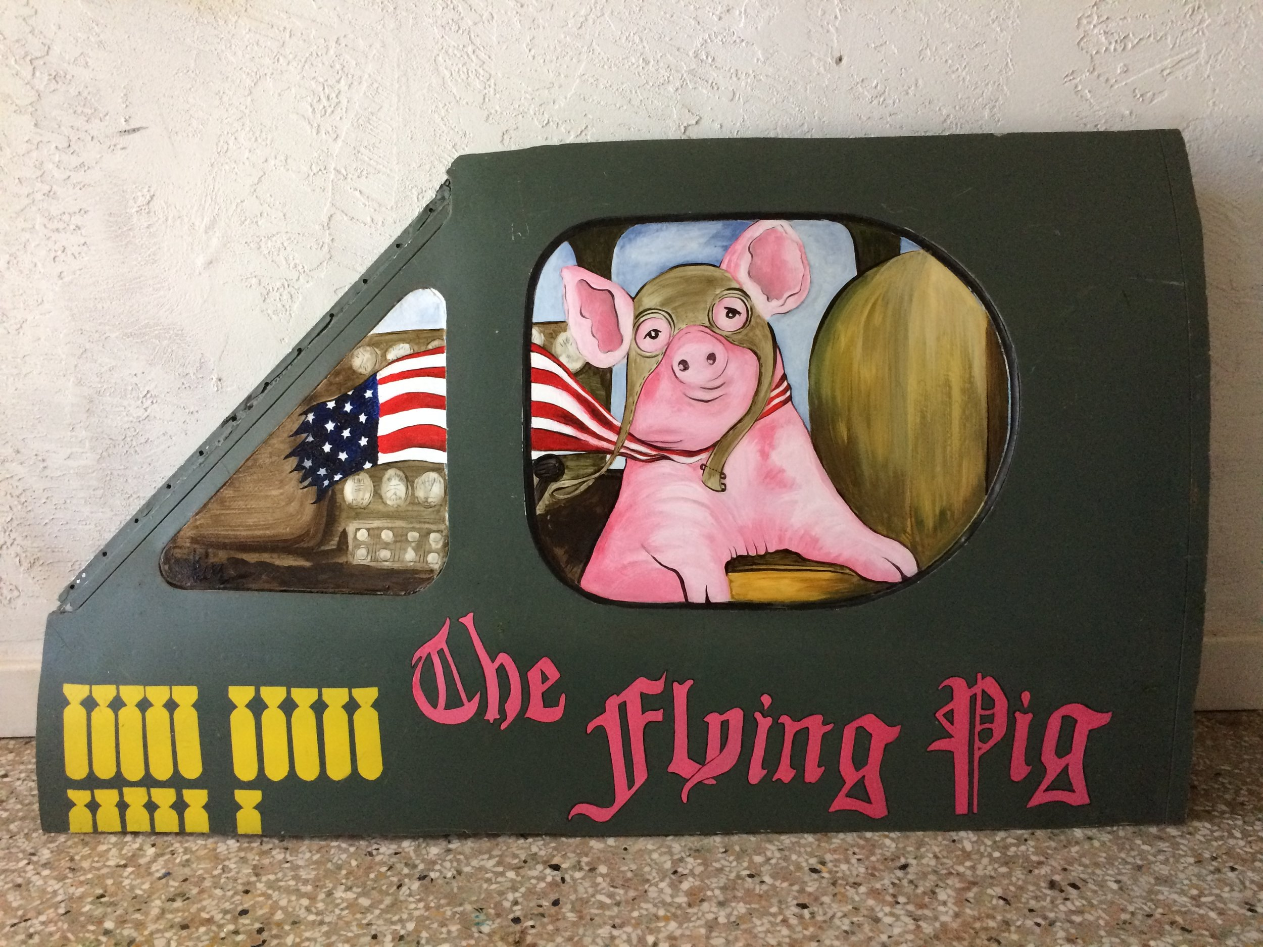 The Flying Pig,painted on glass and wood,  in vintage airplane fuselage . SOLD