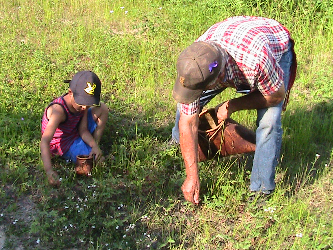 Fred Fraser berry picking, Ft Chipewyan, AB