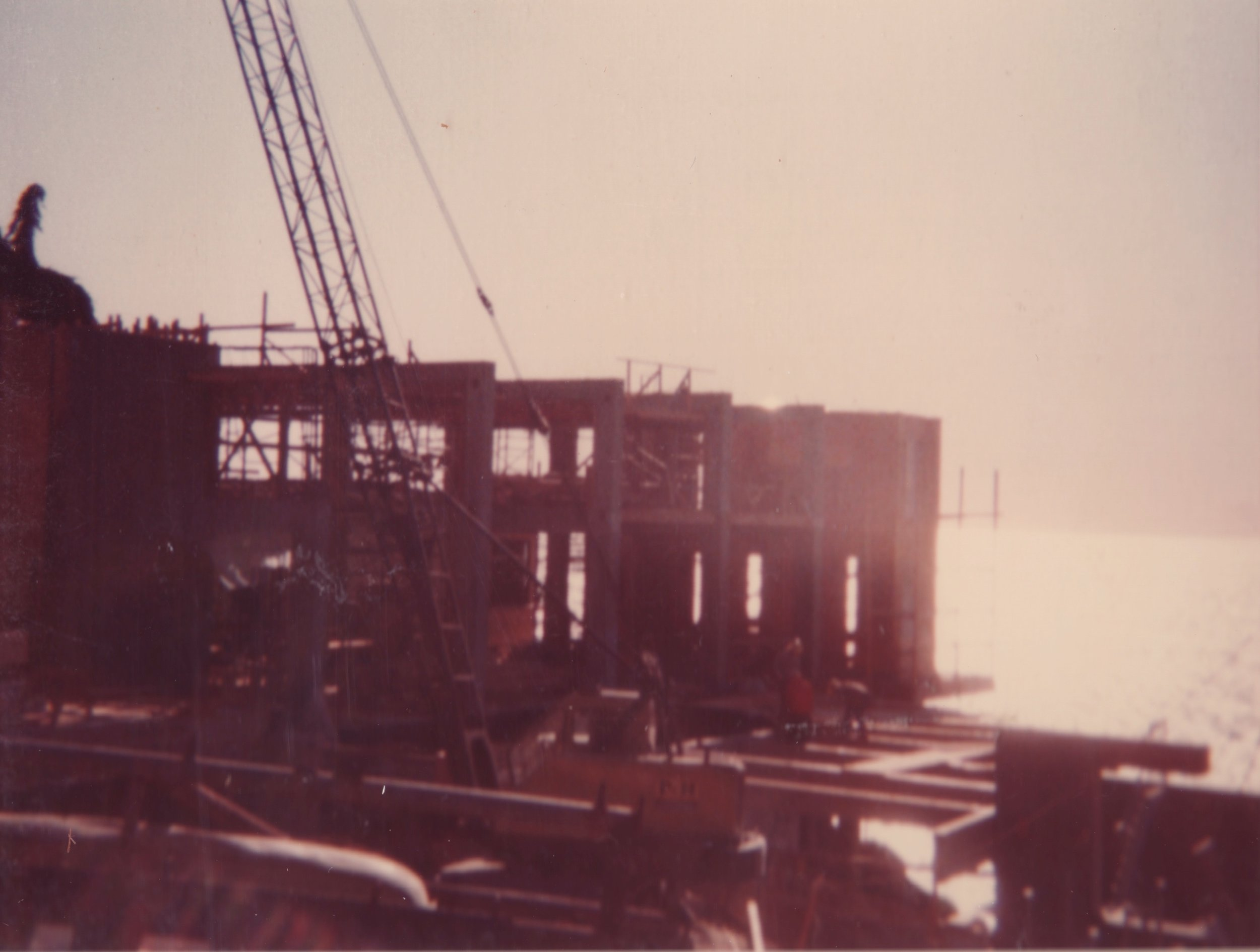 Construction of concrete structure, framing and deck beams being installed, 1975