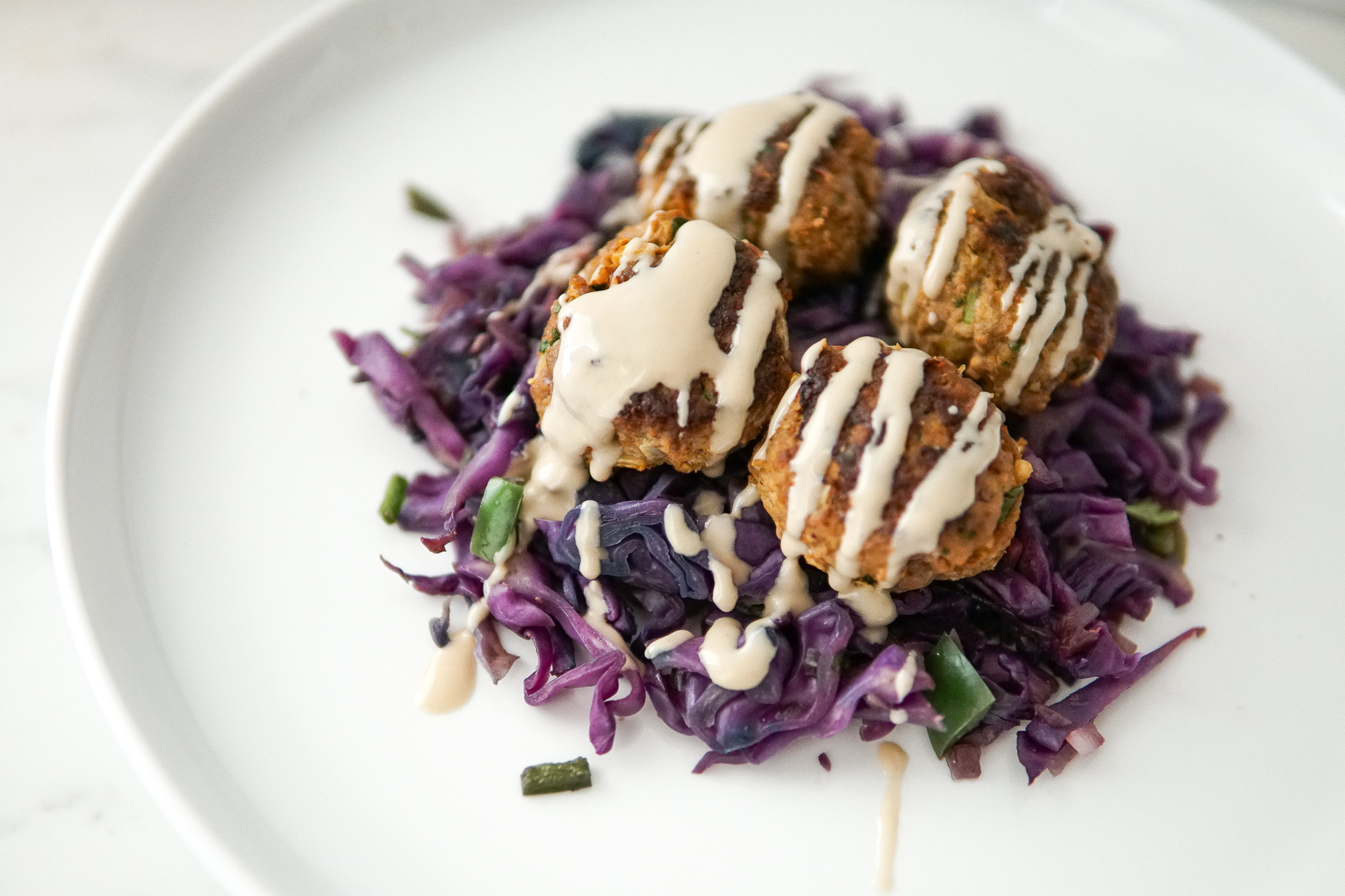 Moroccan spiced meatballs drizzled with tahini