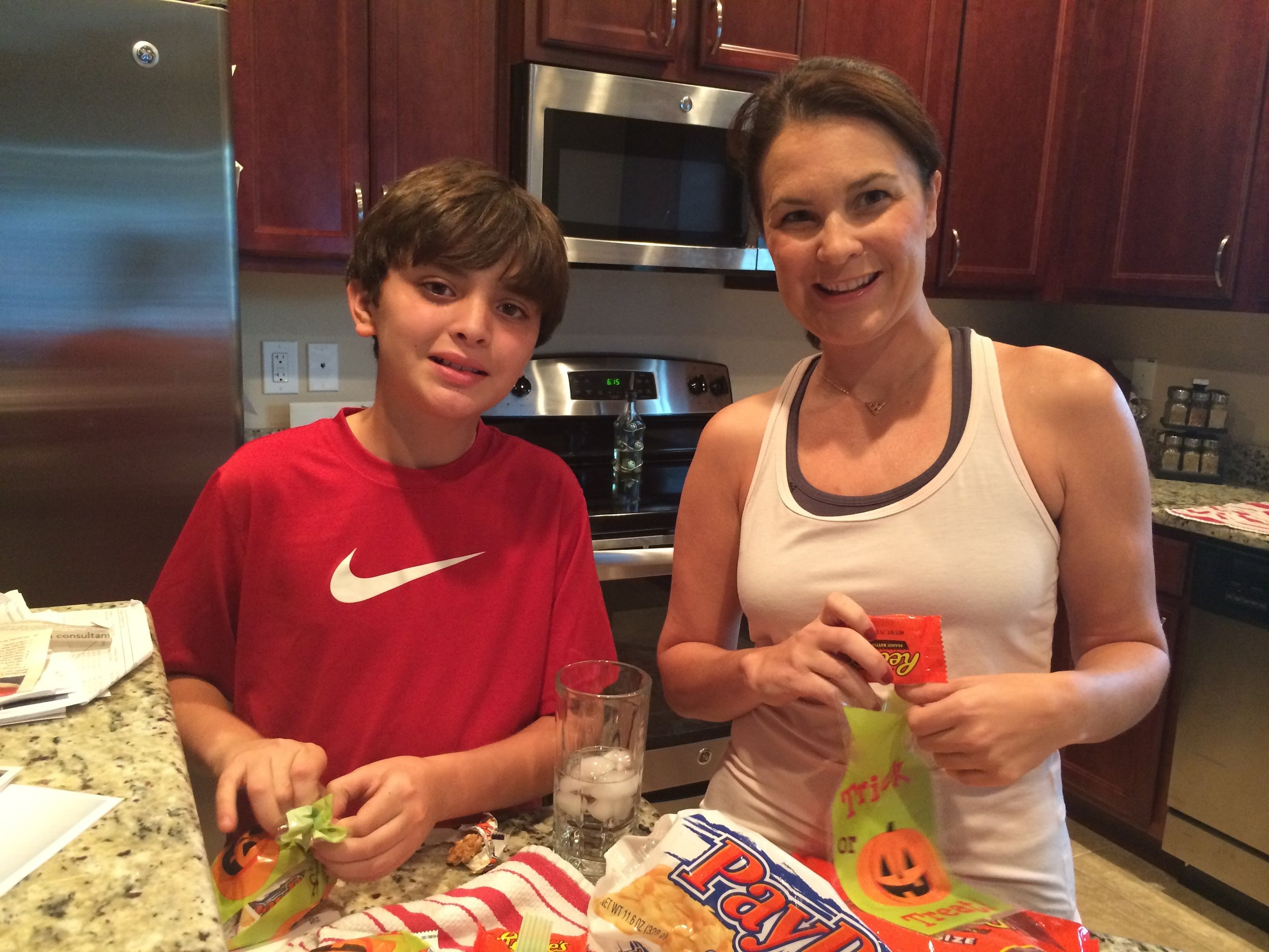 My nephew and me packaging up treats to advertise for a local non-profit
