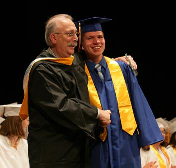 Mr. Satalino poses for a picture with Ben Fickes, Charter Class   of 2016 at the graduation ceremony. Photo courtesy of Lucy Zuo.