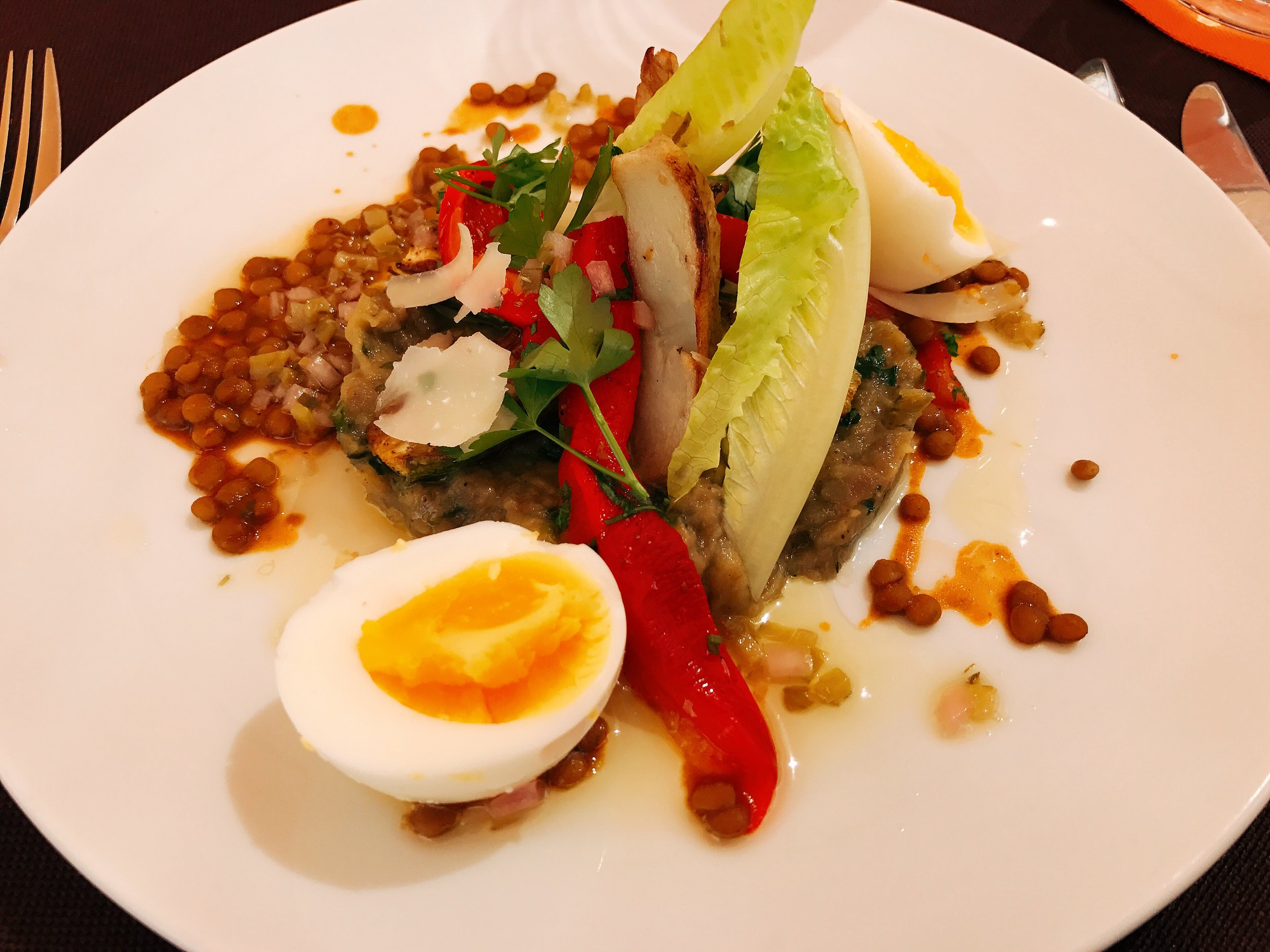 Grilled and Roasted Market Vegetable Salad with Soft Boiled Eggs, Parmesan Shavings, Lentils served with a Herb Vinaigrette