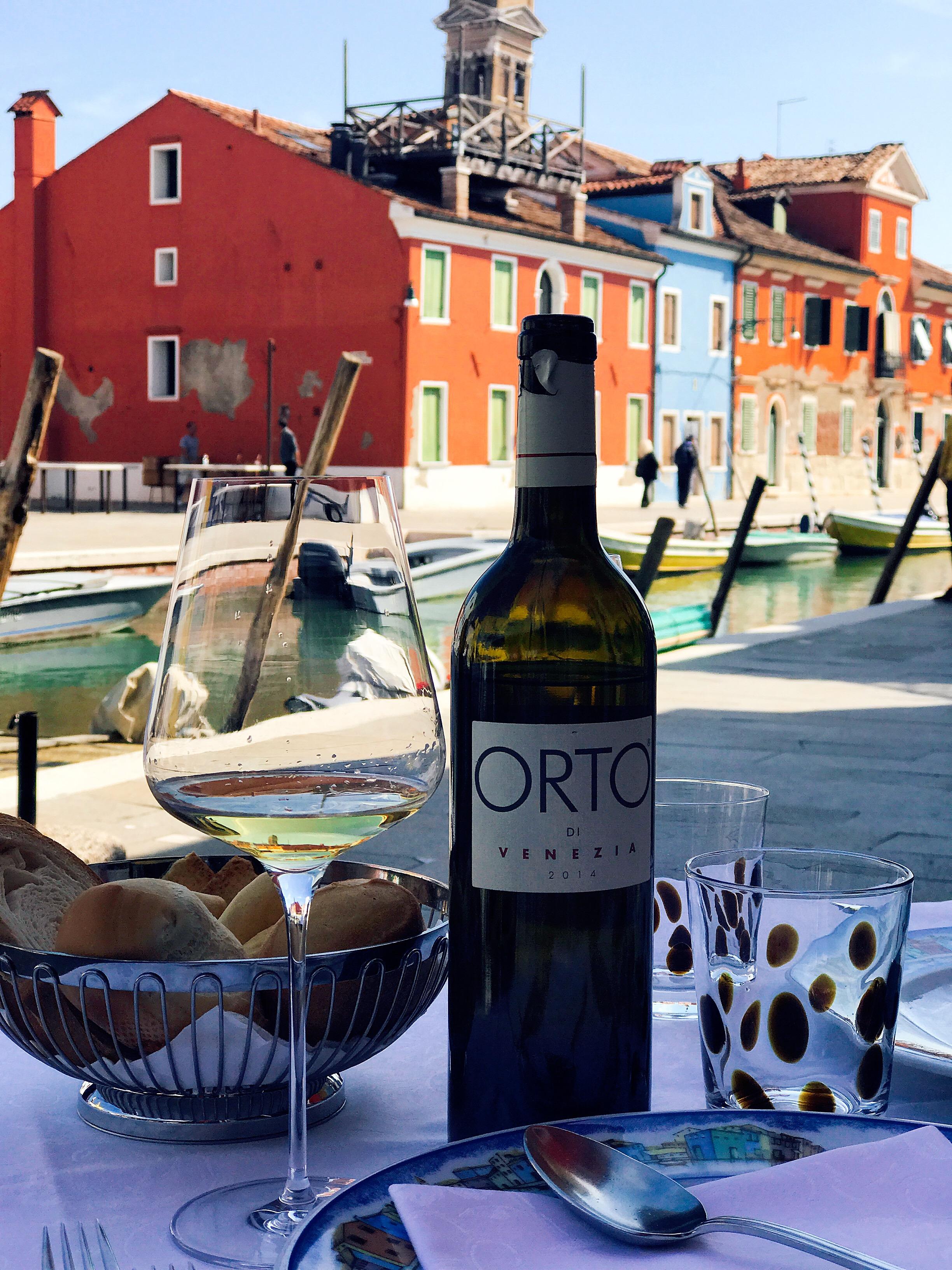 Trattoria al Gatto Nero: Enjoying a bottle of wine produced locally