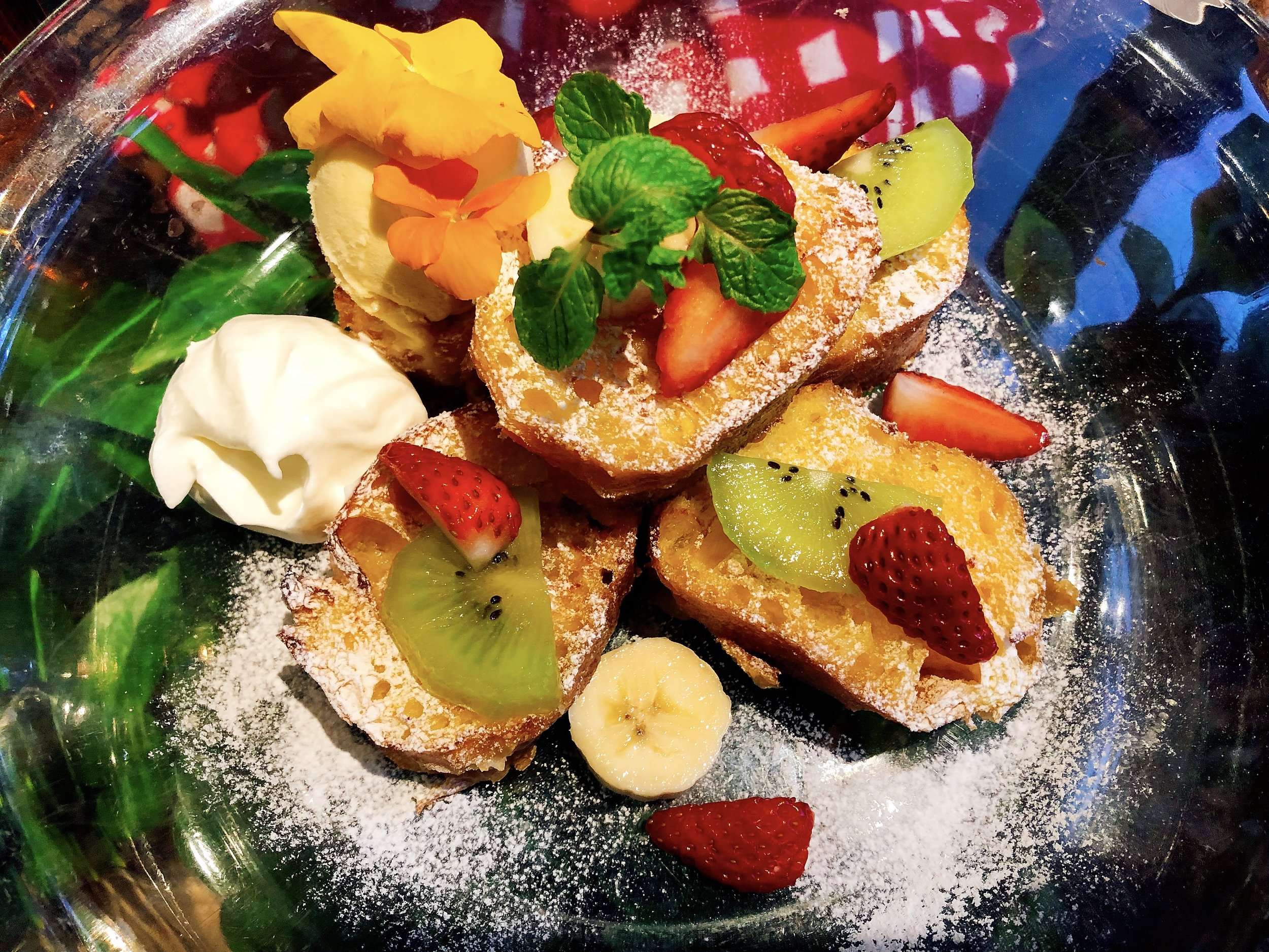 Seasonal Flower French Toast Served With Ice Cream And A Dollup Of Whipped Cream