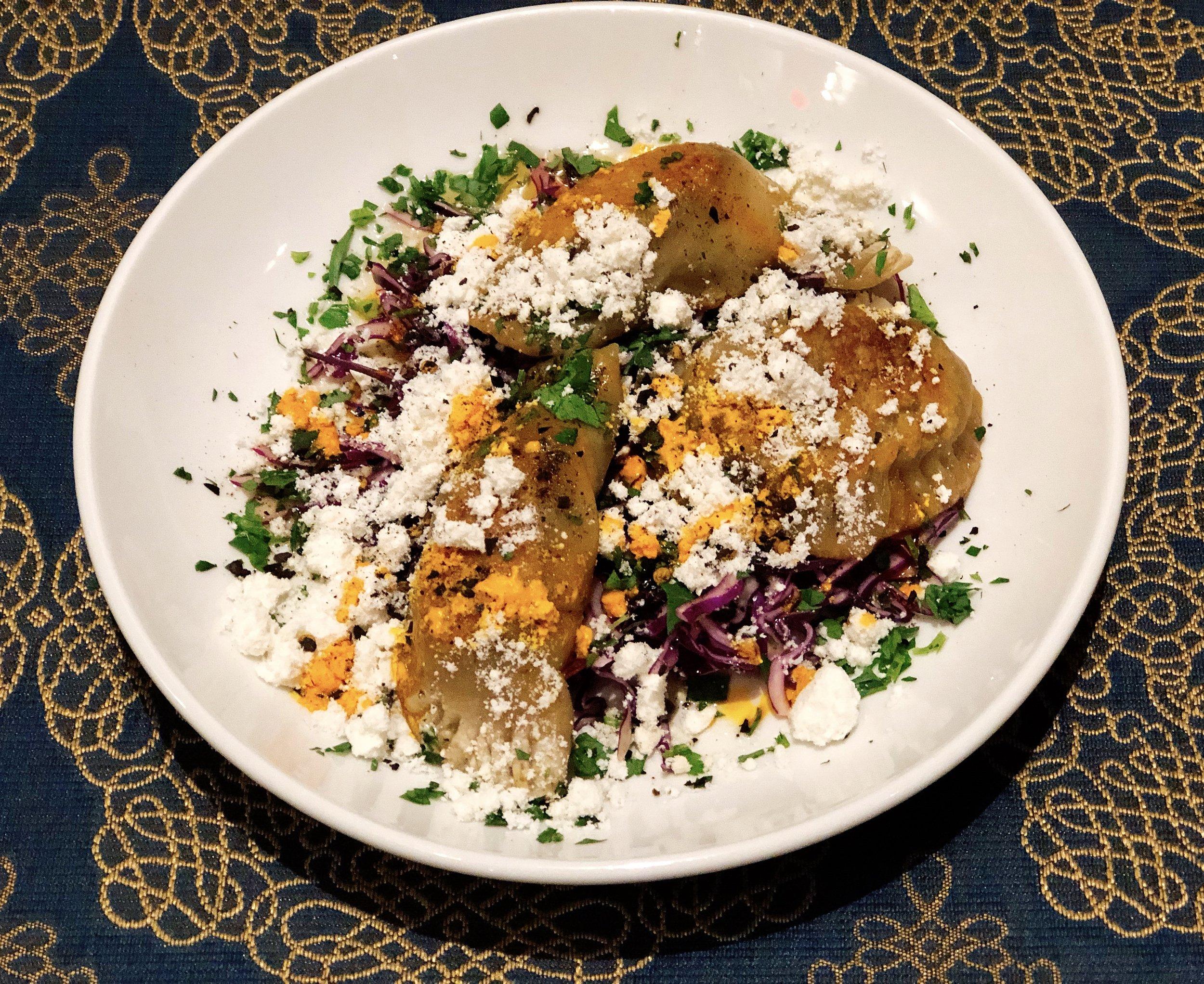 Seared Annatto Pork Dumplings | Cabbage + Brown Butter + Herbs