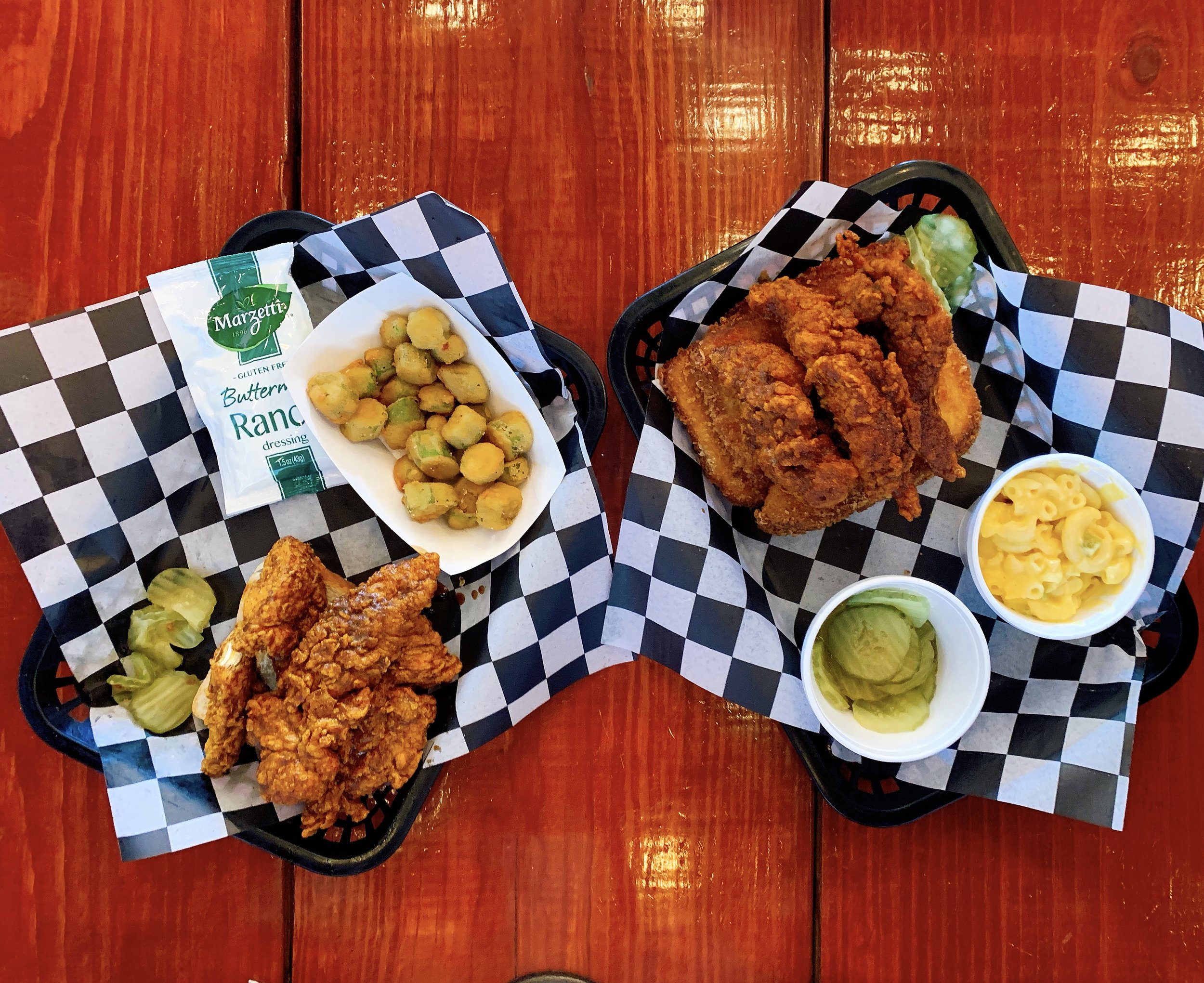 Hot Chicken Tenders + Fried Okra (Left) And Tender Royale + Green Chile Mac N Cheese (Right)
