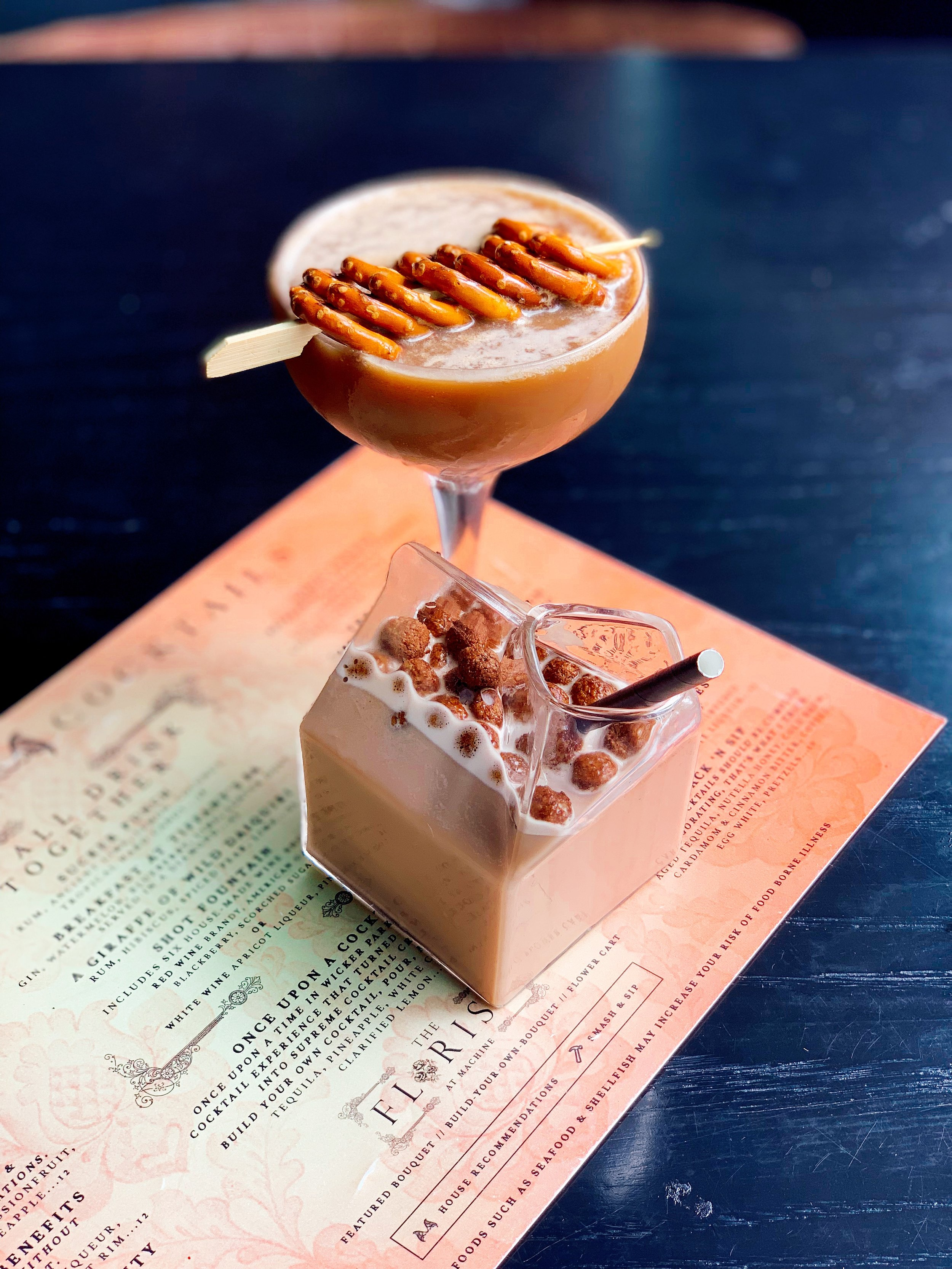 Snack 'N Sip (Top) | Aged Tequila + Nutella Honey + Cold Brew + Cardamom + Cinnamon Bitter + Coffee + Egg White + Pretzels  Alco'Hall and Oats (Bottom) | Bourbon + Cocoa-Puff Infused Oat Milk + Chocolate Liqueur