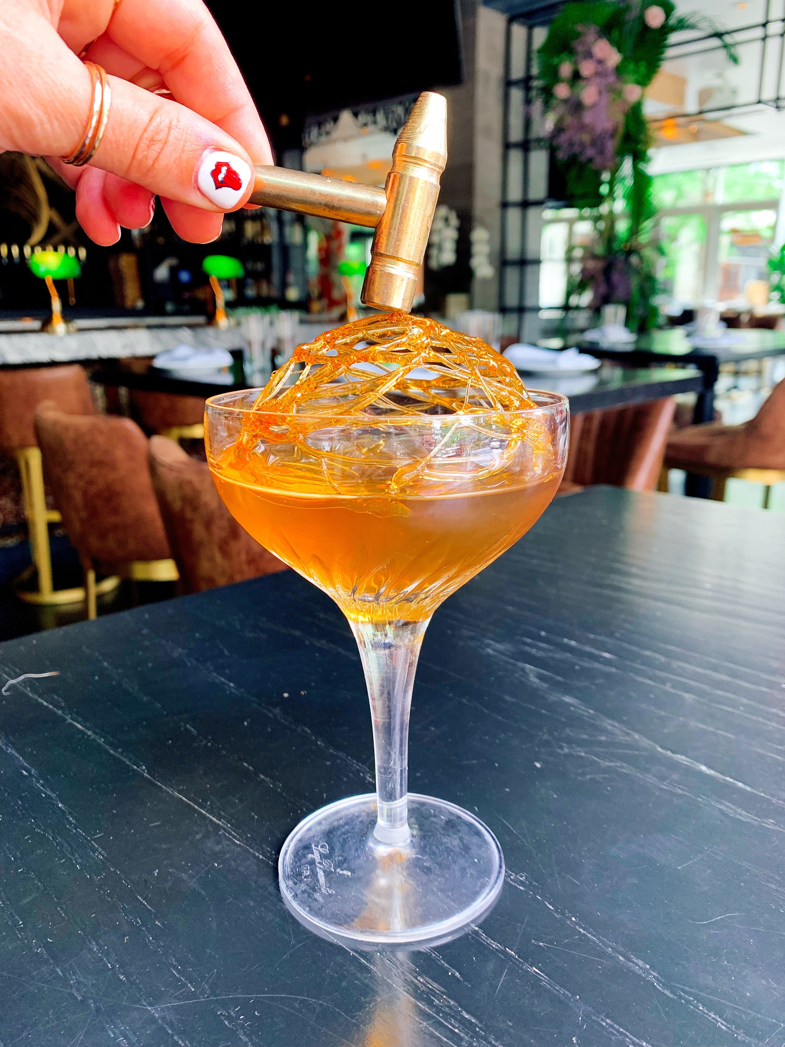 Caged Old Fashioned | Bourbon + Raw Sugar + Lemon Oil + Angostura Caramel Cage