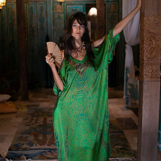 An ode to the majesty of the the green emerald. Our lovely @baliselina in the emerald crown open sleeve long kaftan. Wear it belted or loose any time of the day
