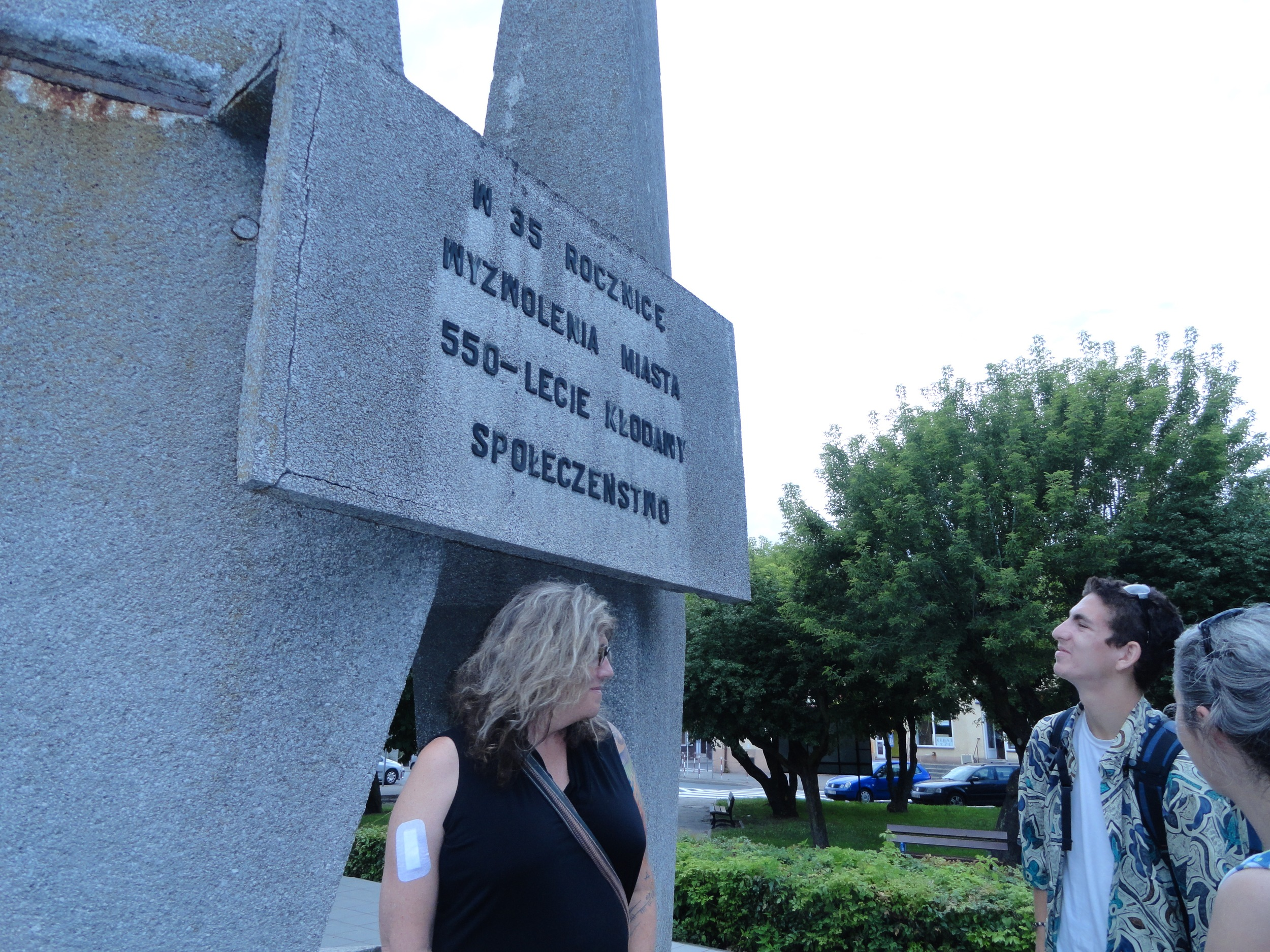 Back side of WWII memorial. Susan Stryker, Oscar Klausner and Monika Rogoska-Stangret. The text says the statue memorializes the 35th anniversary of WWII and the 550th anniversary of the founding of the town!