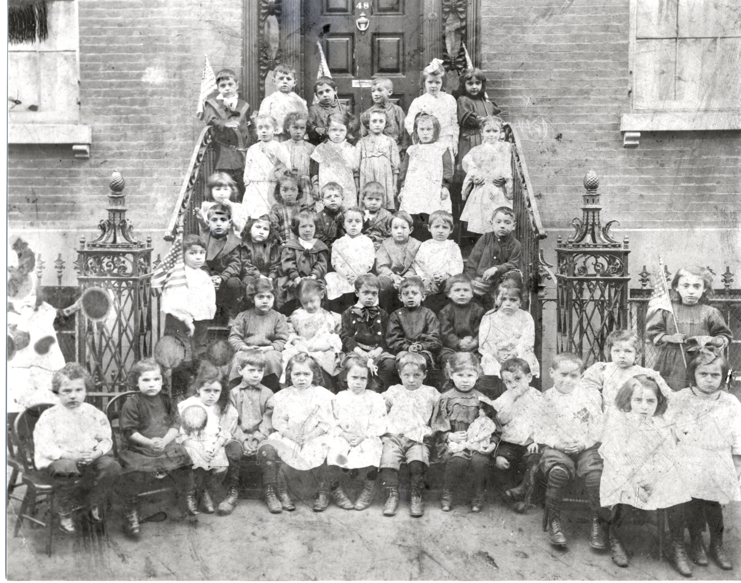 Sol Napolsky at the Henry Street Settlement House kindergarten, 3rd row, right, leaning against bannister.