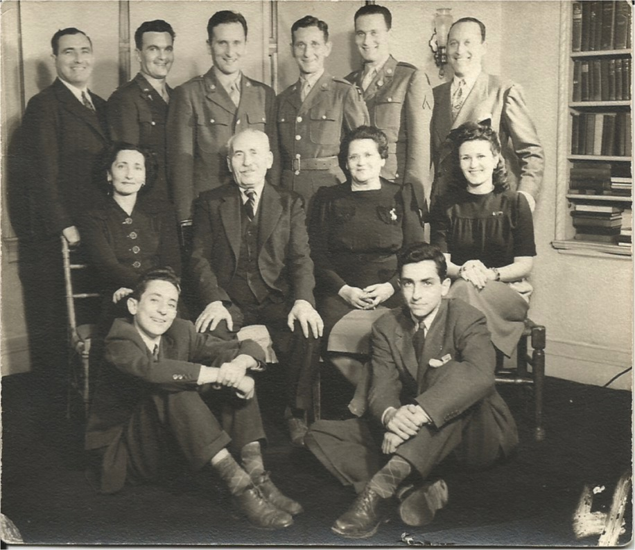 Leah Axelrod and Morris Miller, seated with daughter Mickey Miller Klausner on left and daughter-in-law Shirley Rosner Miller on right. Mickey's sons William, l, and Robert, r on floor. Standing: David Klausner, Si, Oscar, Stanley, Irving and Mannie.
