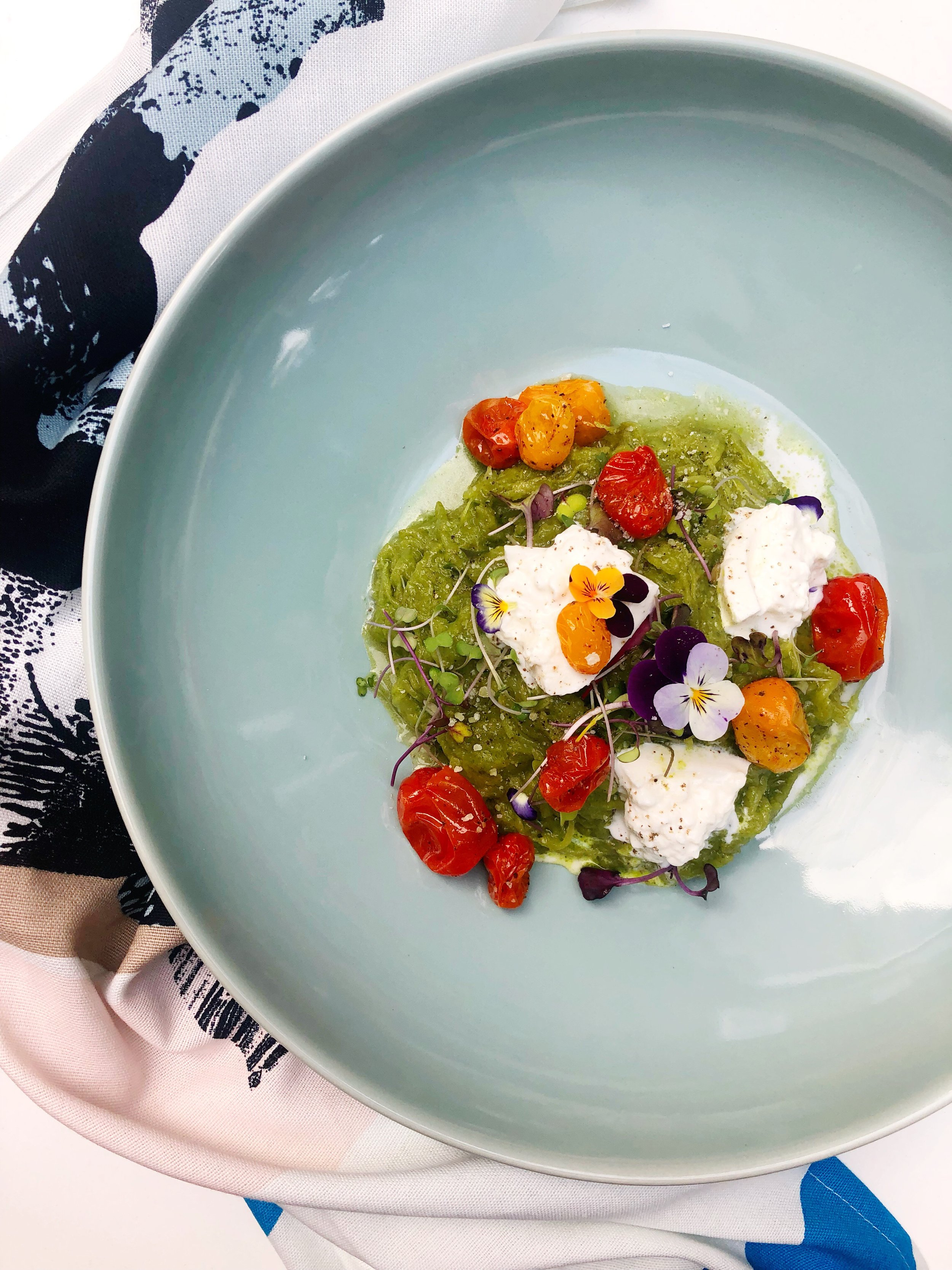 PESTO SPAGHETTI SQUASH WITH BLISTERED CHERRY TOMATOES AND BURRATA