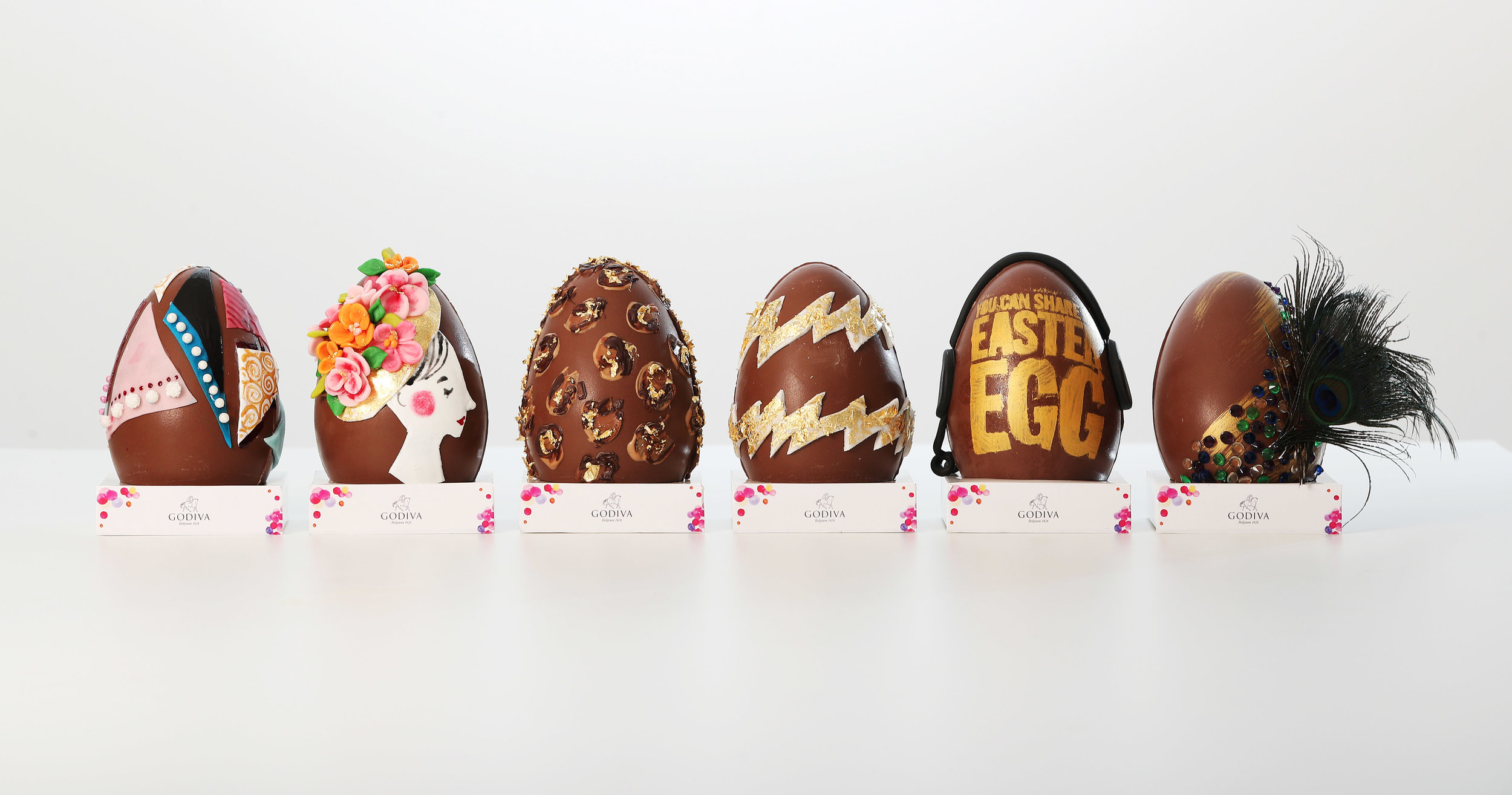 The completed eggs decorated by Godiva's creative influencers.  Left to right; Sophie Tea, Emma Block, Gizzi Erskine, Rosie Fortescue, Henry Holland and Candice Brown