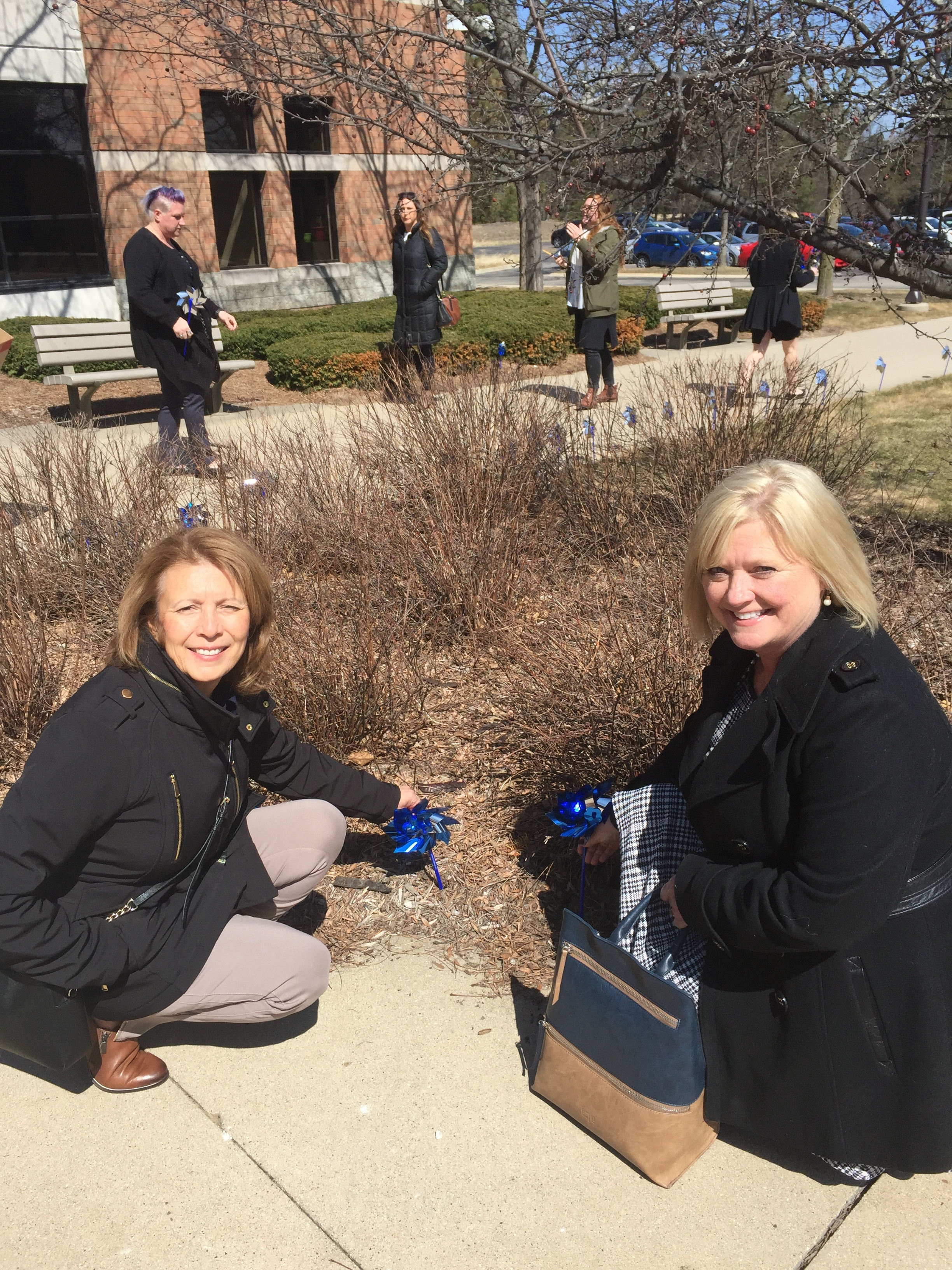 Board Member Pat VerDuin and Exectuive Director Darcy Komejan plant pinwheels