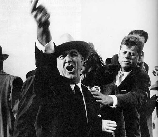 This is LBJ screaming at a plane so JFK can be allowed to speak, and JFK is trying to calm them down.