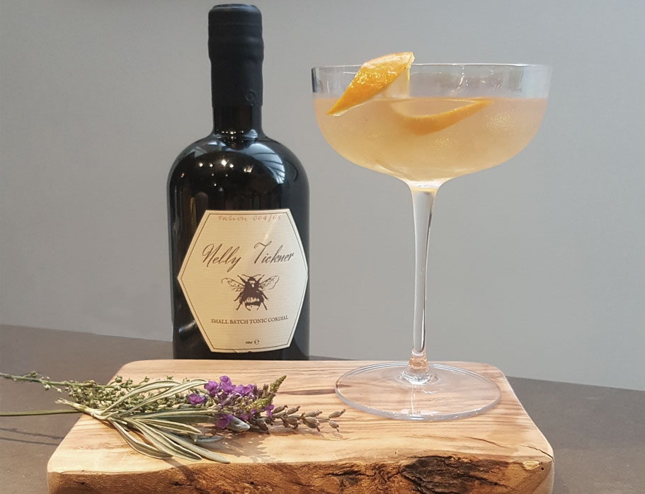 A bees knees cocktail, made with Nelly Tickner tonic cordial, served in a coup glass