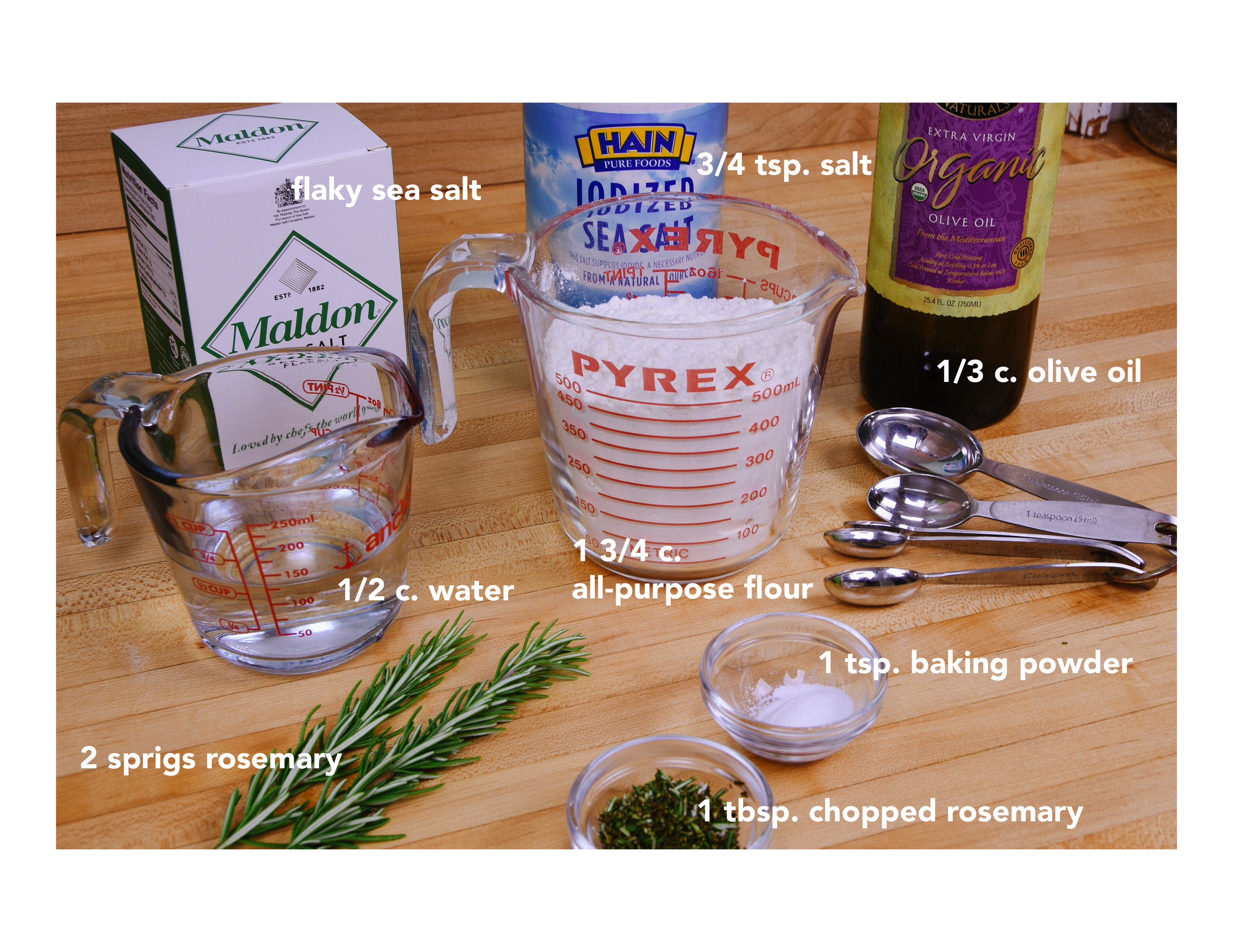 Ingredients:  -1 3/4 cups unbleached all-purpose flour  -1 tablespoon chopped rosemary plus 2 (6-inch) sprigs  -1 teaspoon baking powder  -3/4 teaspoon salt  -1/2 cup water  -1/3 cup olive oil plus more for brushing  -Flaky sea salt such as Maldon