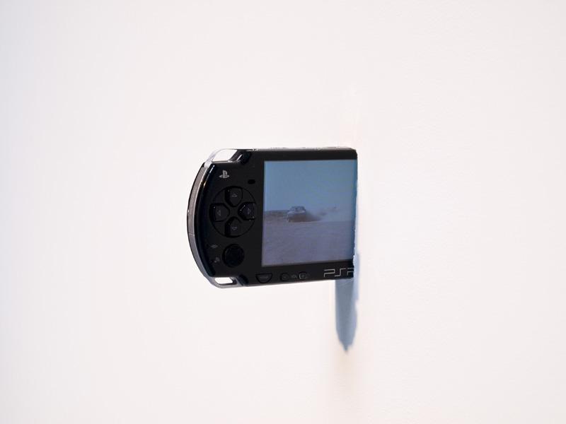 Interceptor Circuit , 2010, digital video on Sony PSP game system, looped, intersecting a wall cinematography: Gotaro Uematsu, photography: Josh Raymond, edition 1/2
