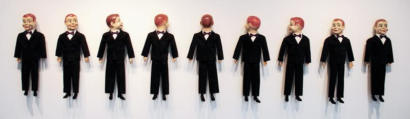 Dizzy, 2009-10, installation of 9, 22 x 126 inches, vintage amateur ventriloquist dummies circa 1930-1950