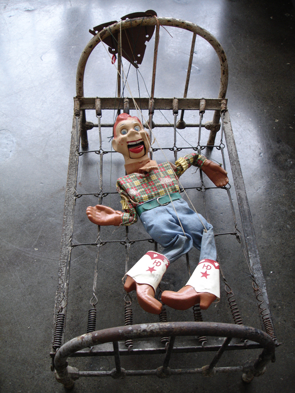 Broken , 2009-10, 13 x 22.5 x 13 inches, vintage marionette; antique doll bed