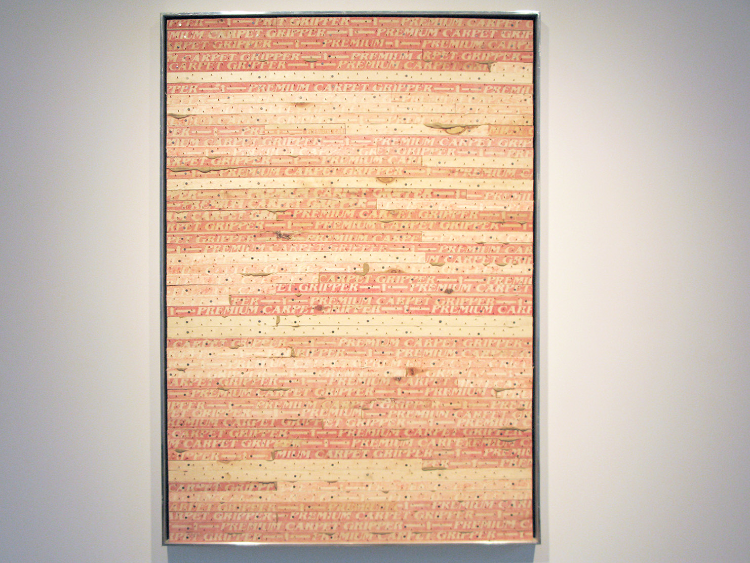 Untitled (Study in Red), 2006, carpet strip, salvaged museum frame, 42 x 29.5 inches