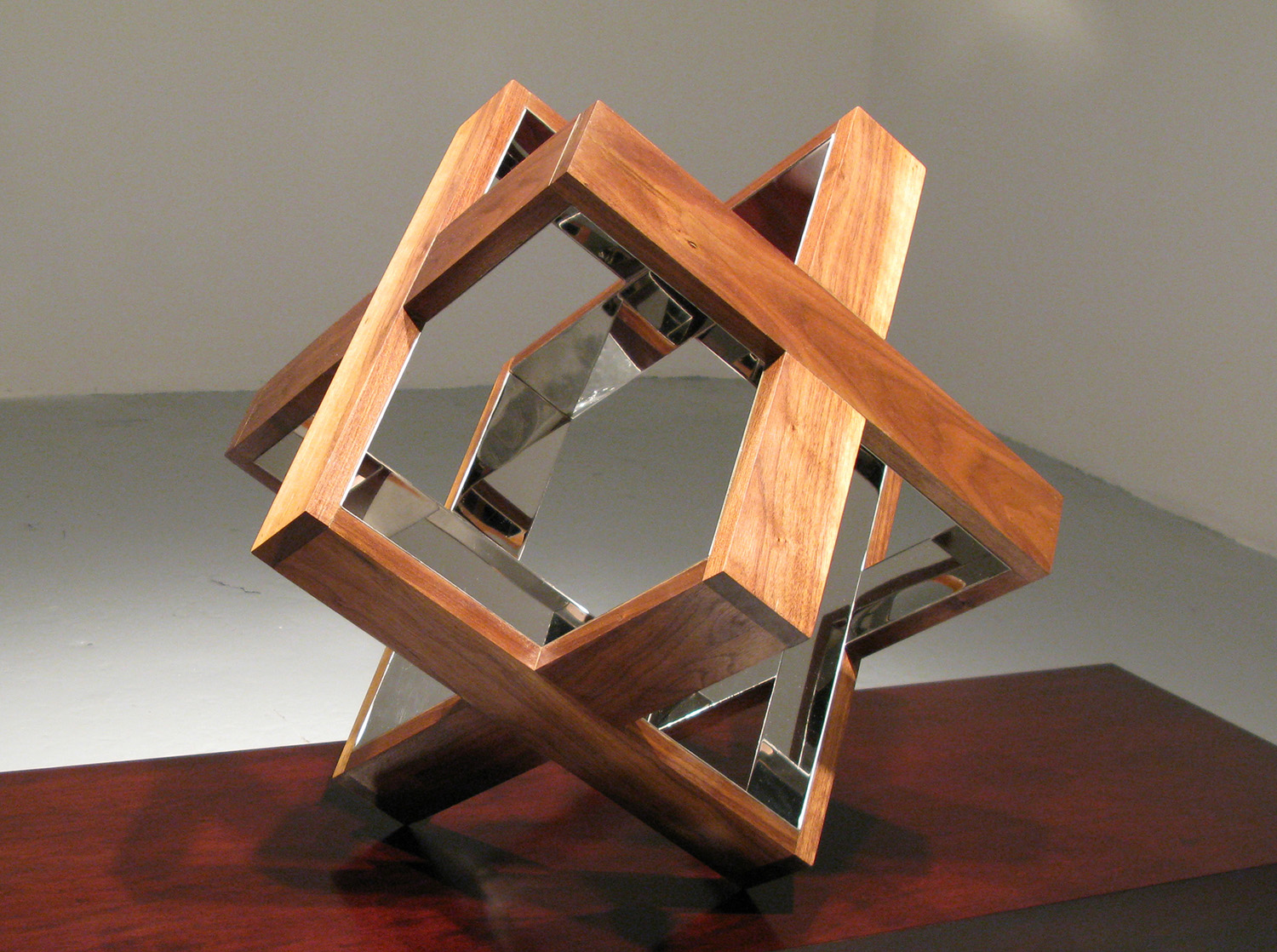 Strip Cube (Walnut), 2009, walnut, mirrored stainless steel, 18 x 18 x 18 inches